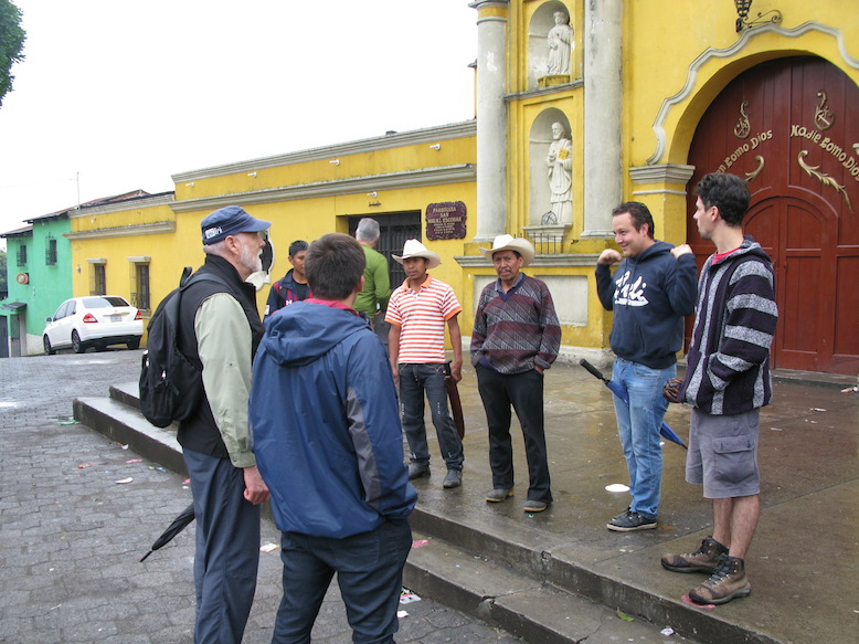 One of our coffee farmers, Don Filiberto (in the cowboy hat), and two of his sons, meet a group in the main plaza of San Miguel Escobar.