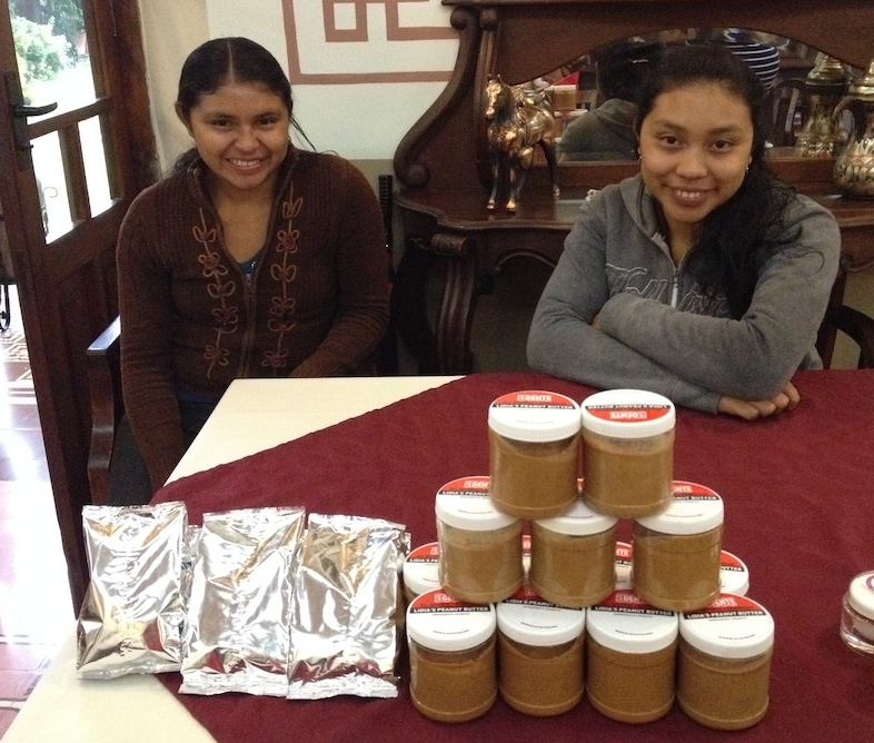 Lidia and Lilian sell their peanut butter and bags of roasted peanuts at a recent artisan market held in Antigua.