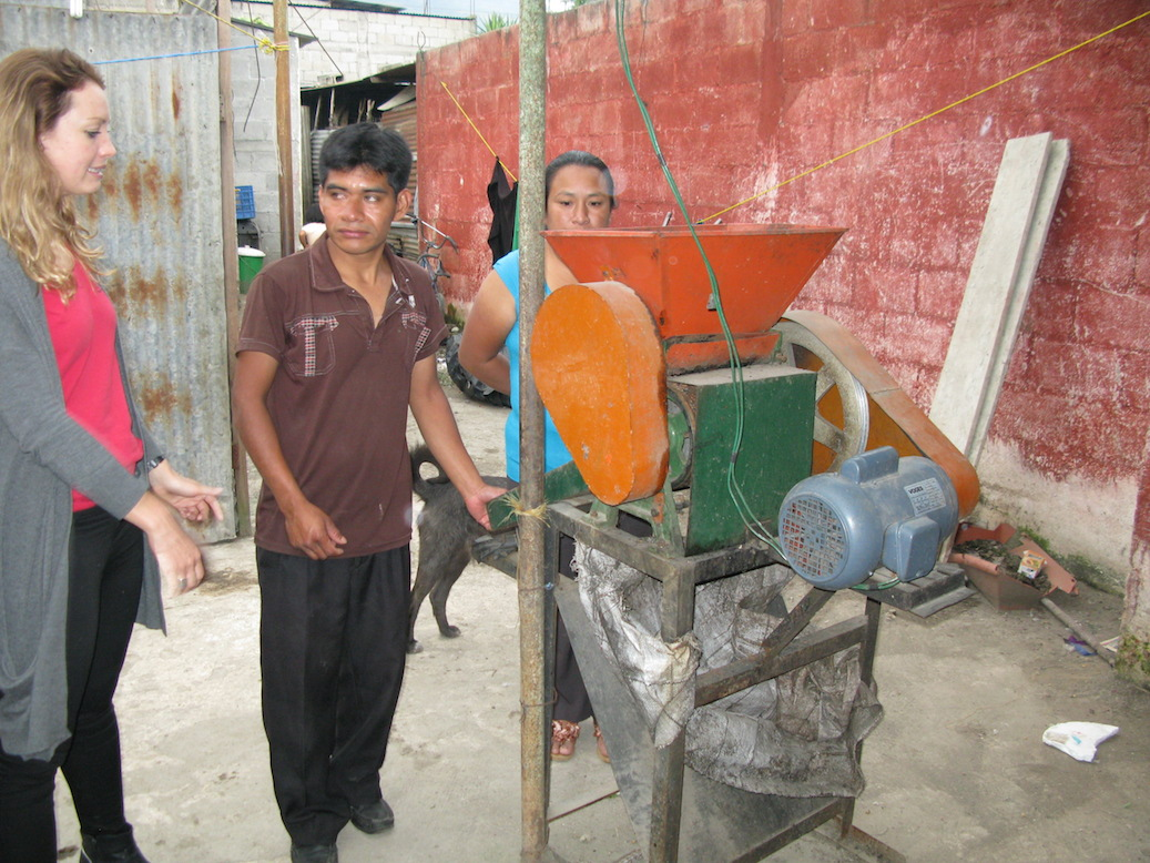 Armando and Virgilia demonstrate the motorized pulpero, which they use to remove the pulp from the red, mature coffee fruits.