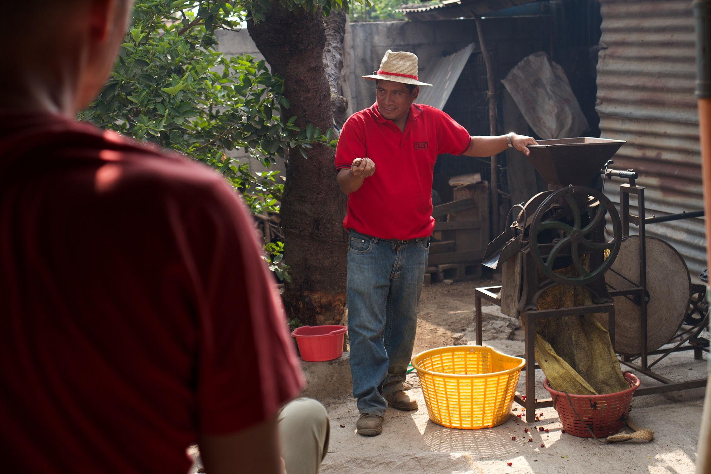 Eduardo gives a lesson about the cycle-powered pulpero that removes the fruit from the coffee seed.