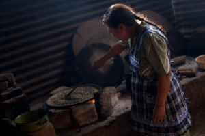 Green Coffee is roasted the traditional way - on a   comal above a flame.