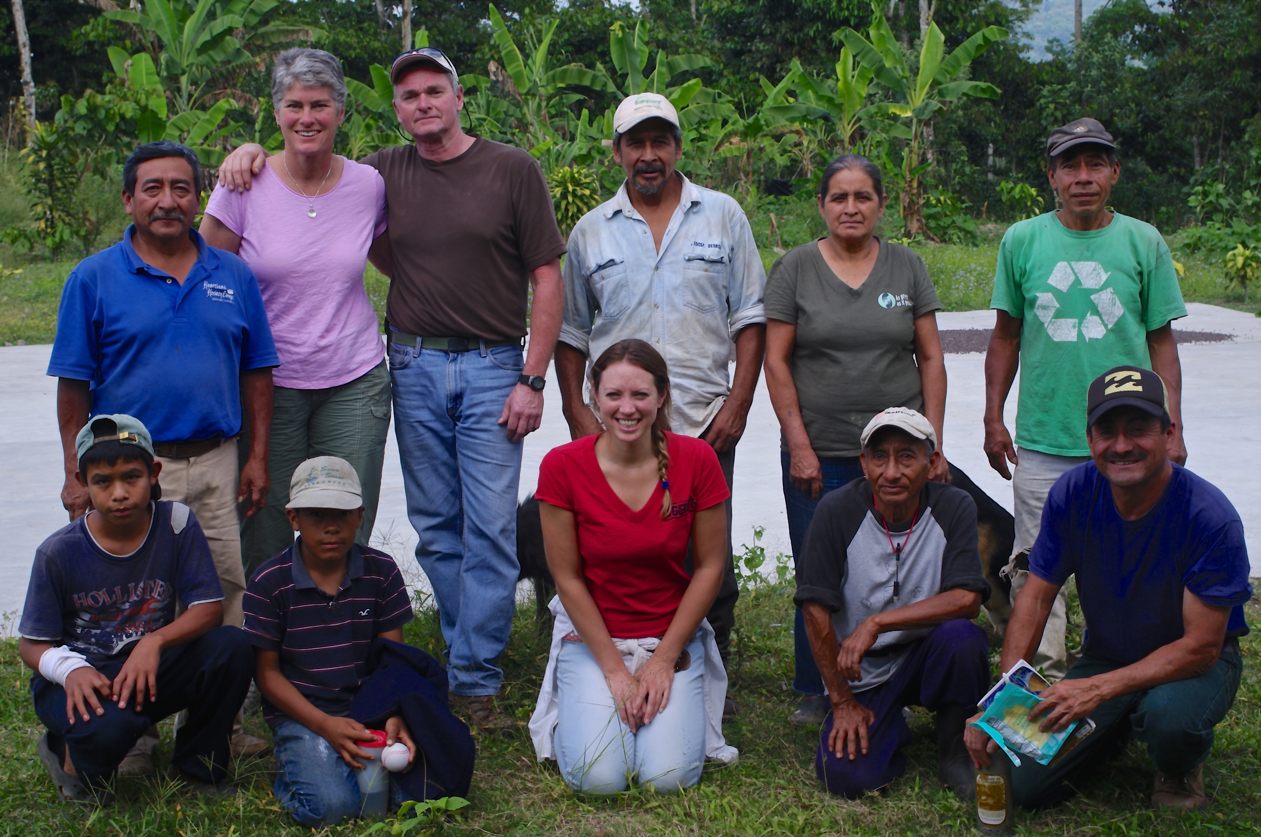 Peggy and Rick pose with the farmers from the cooperative in Santa Anita, where they traveled in order to help with the tree nursery.