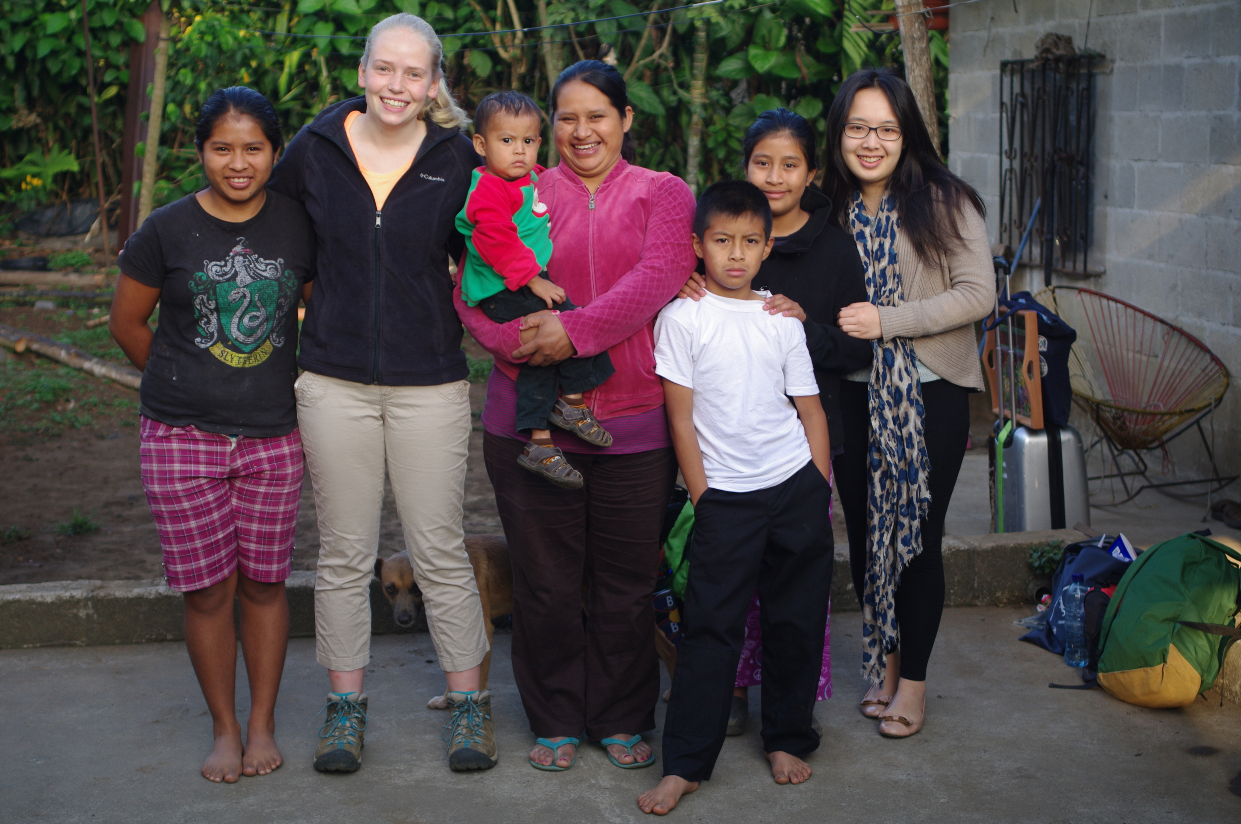 Students pose with cooperative member and home-stay 'mother' Elena, her four children and niece