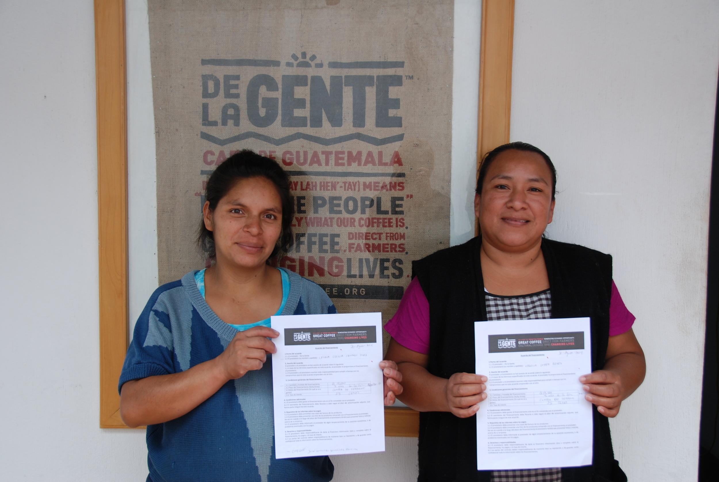 women showing certificates