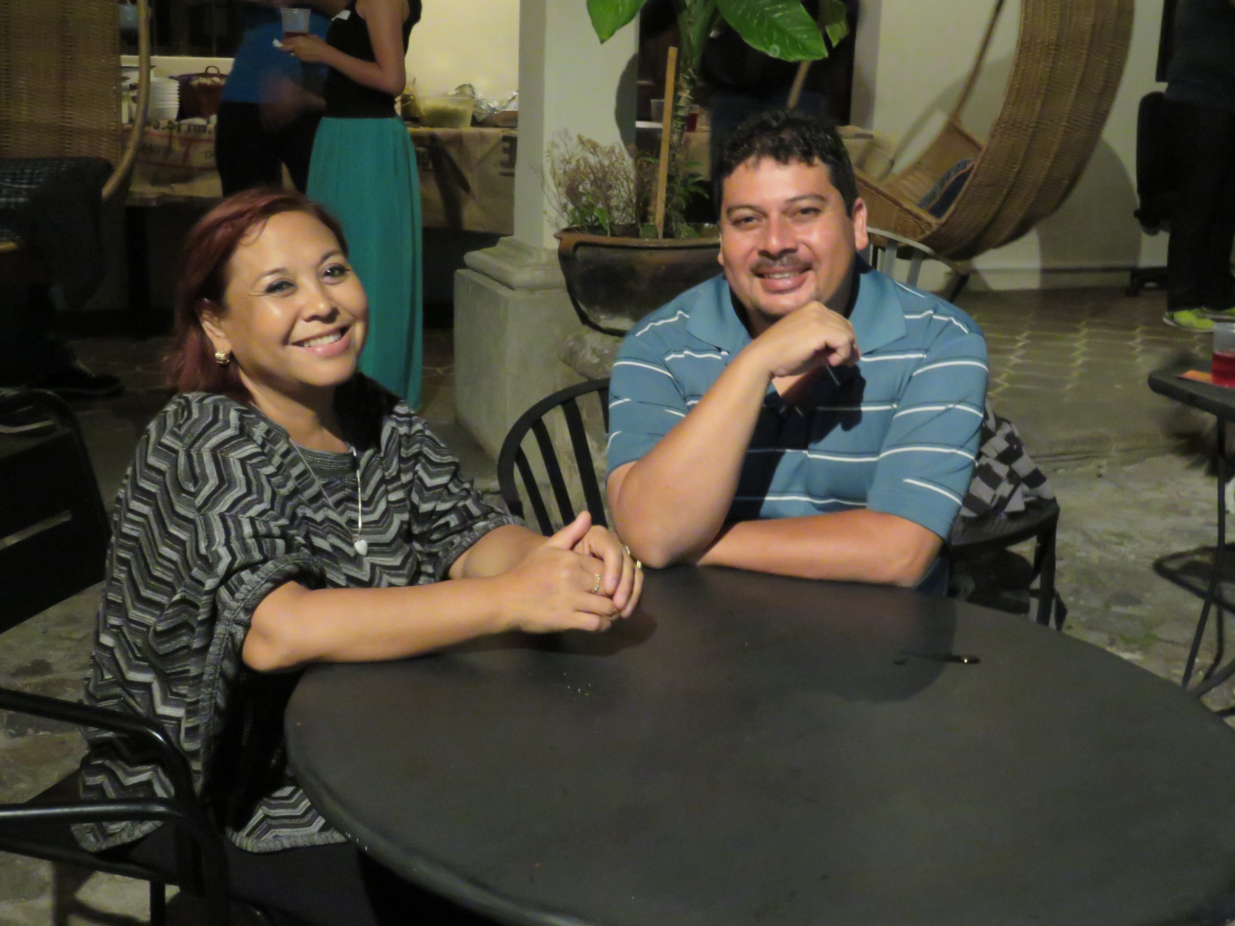couple smiling at table