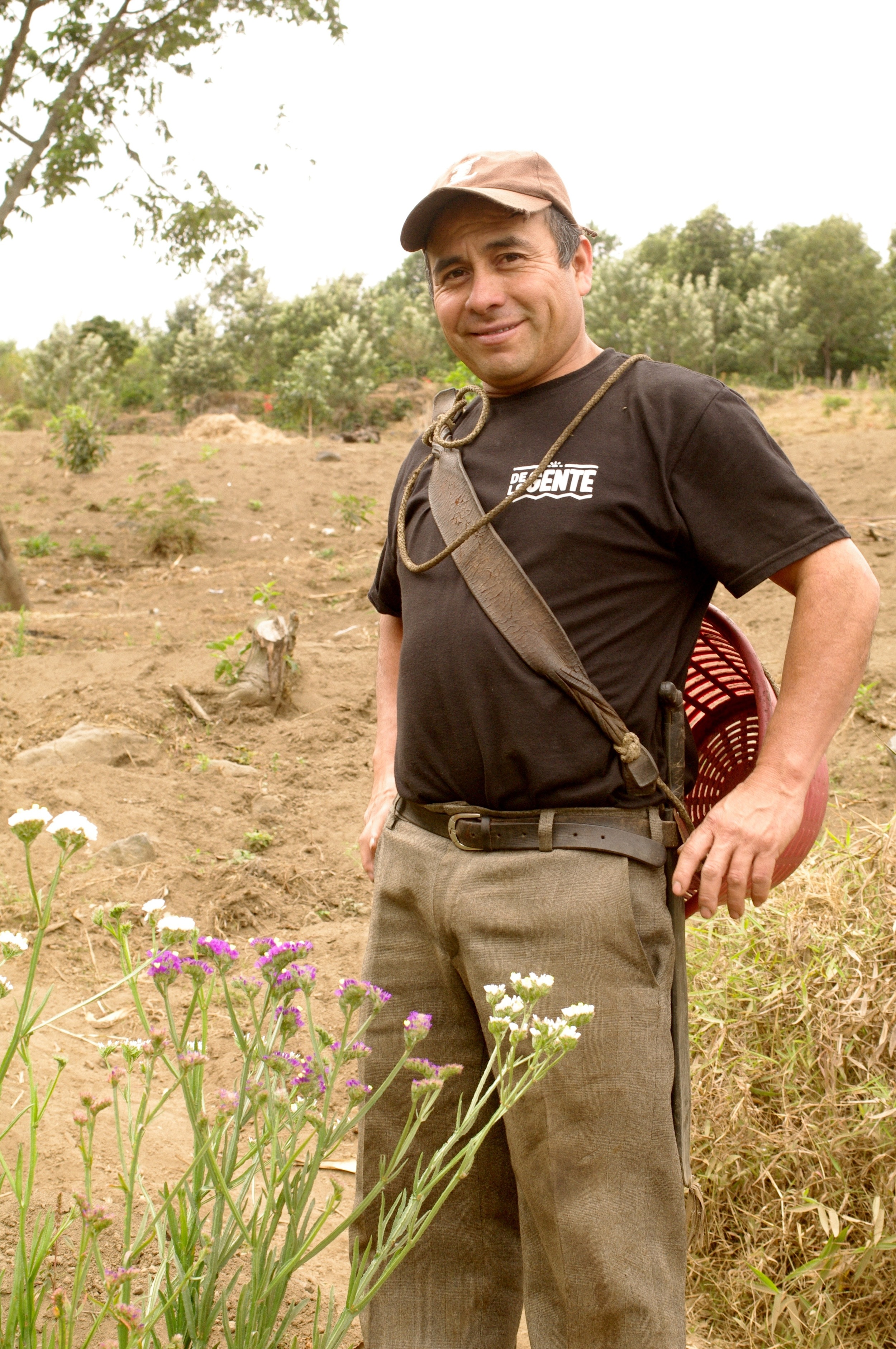 Froilan with the flowers that opened the opportunity of working with coffee.