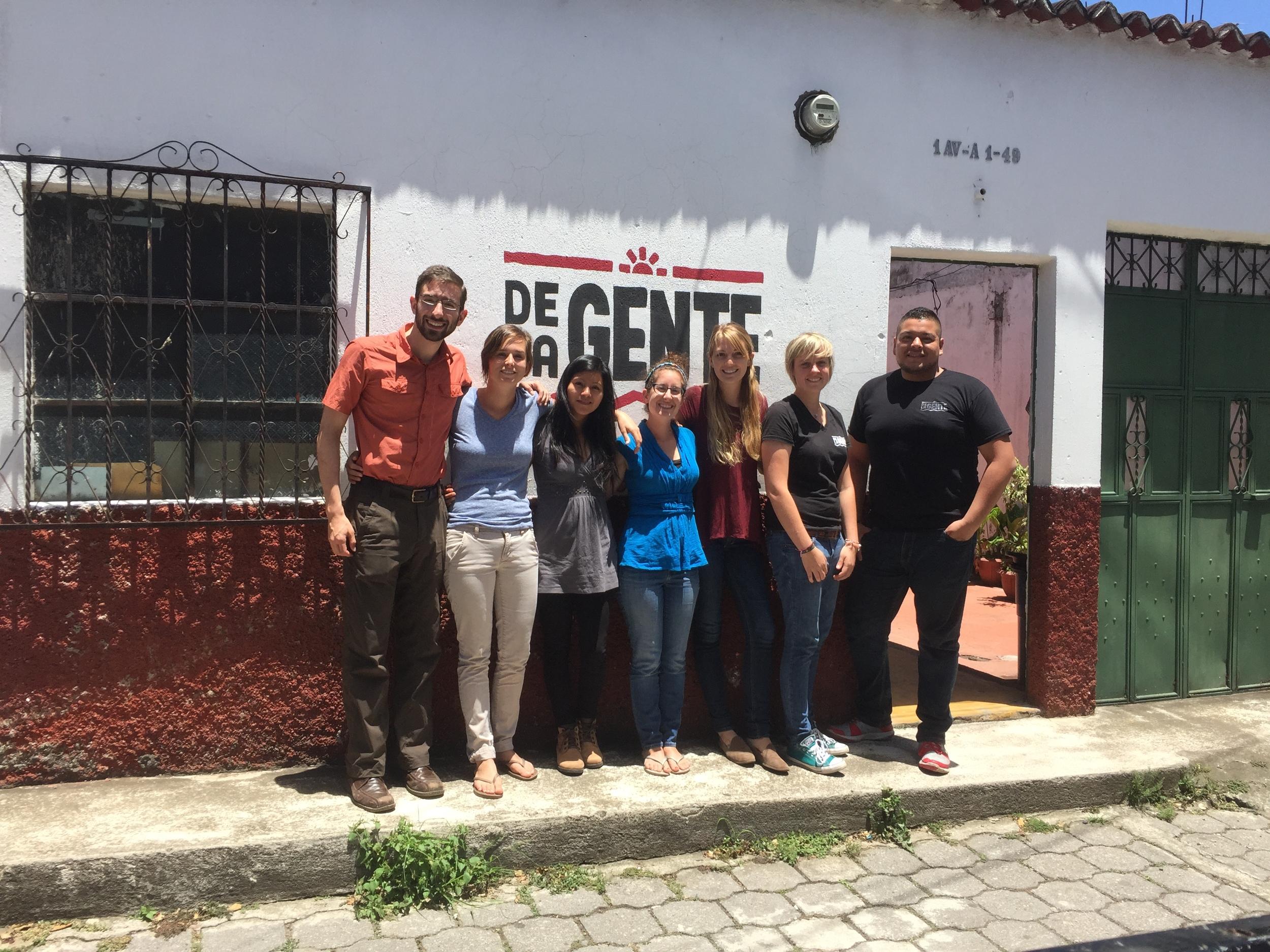 Lola with the team at De la Gente