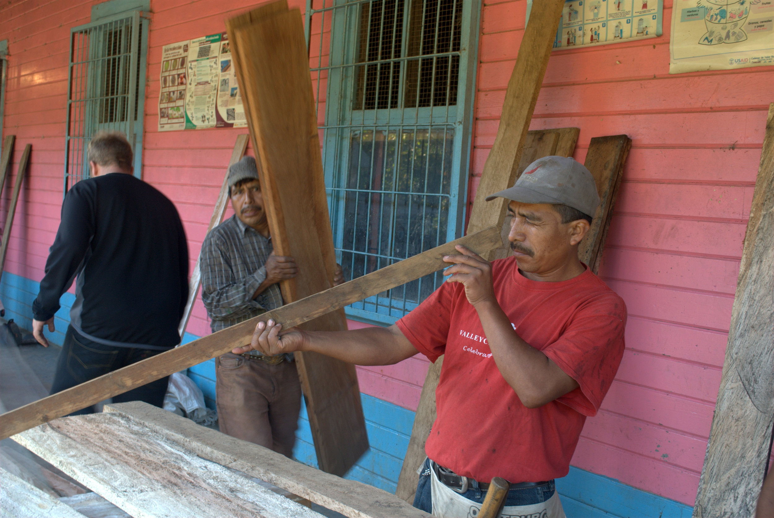 ACUPDIC leader Maximo Velasquez, checking the measurements on his Drying Beds.jpg