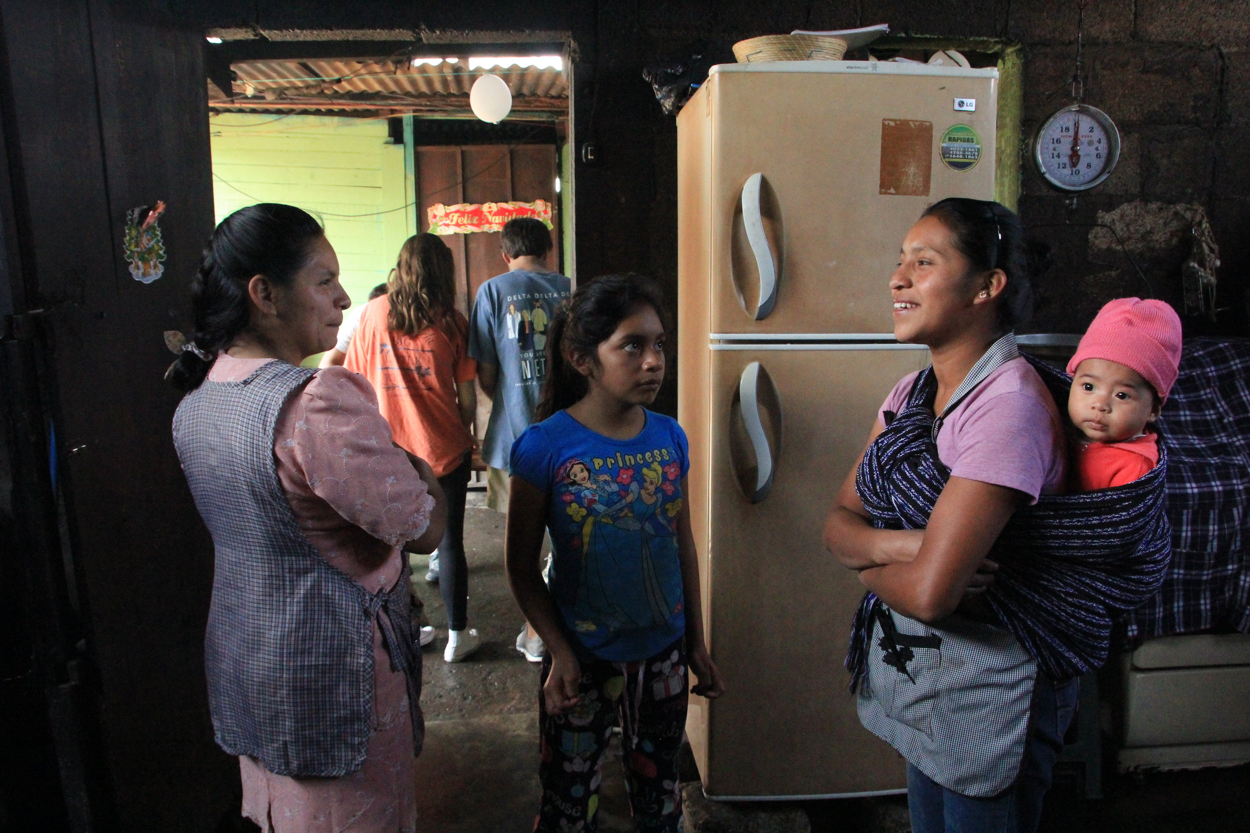 Lesbia (left),her daugher (center), and Valeriana with her baby (right) during a pepian cooking class with student's from Vanderbuilt University.