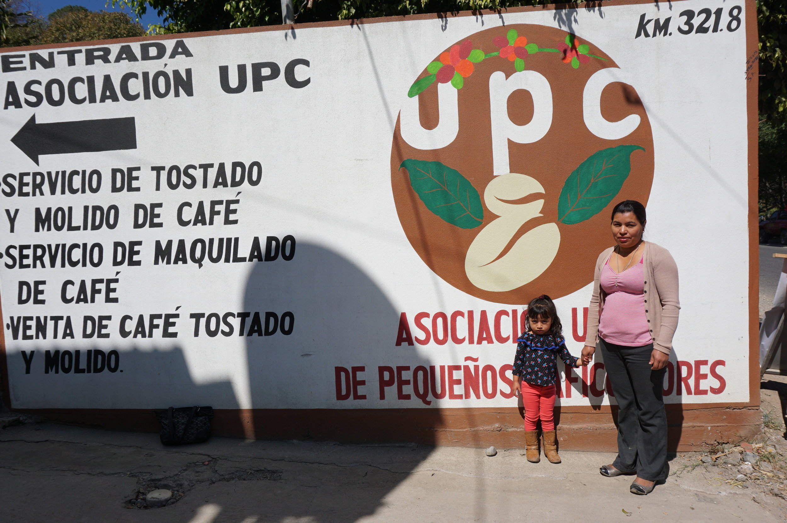 Blandi and her daughter at the UPC Cooperative headquarters