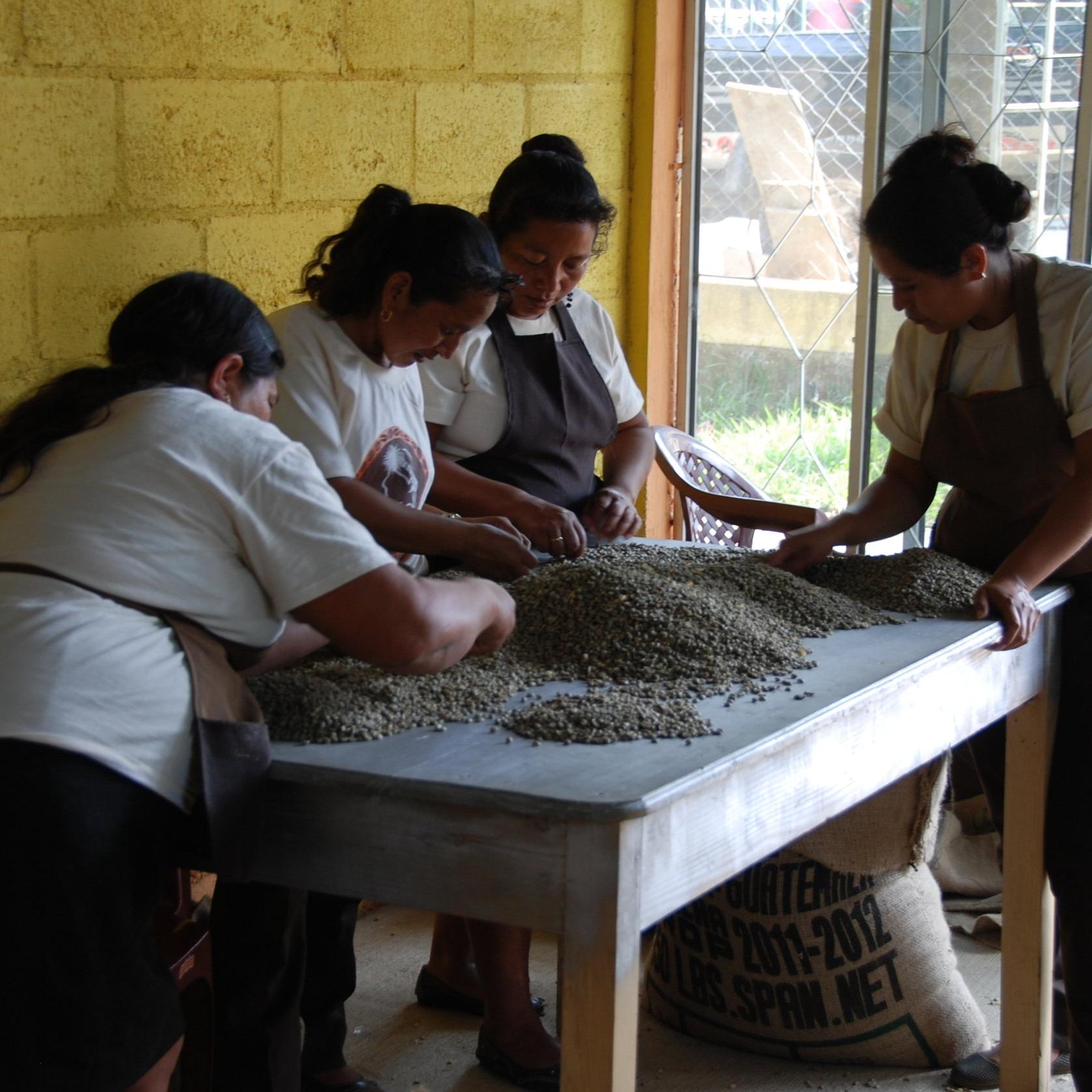 women grinding coffee