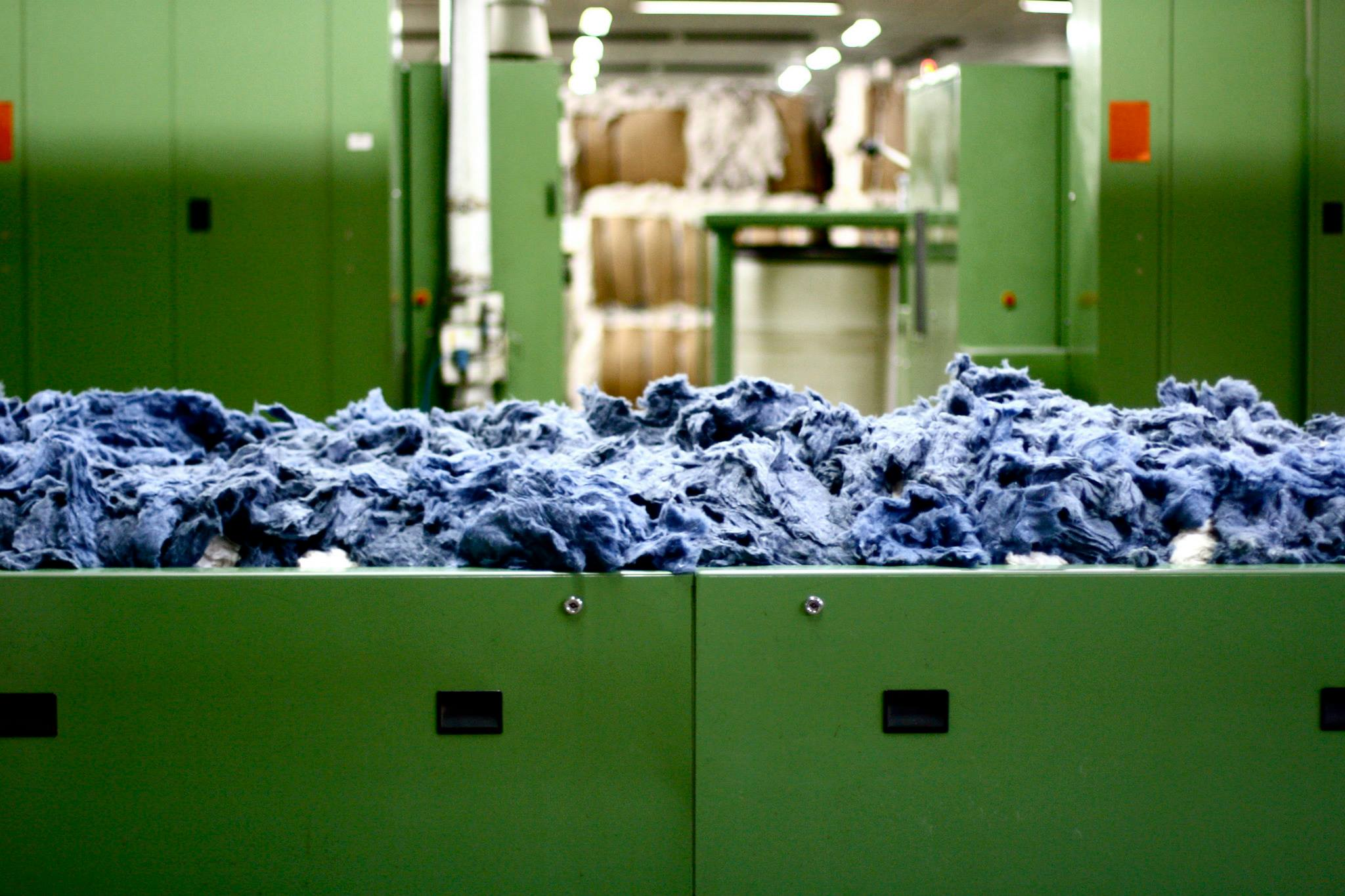 Denim waste that has been turned back into fiber