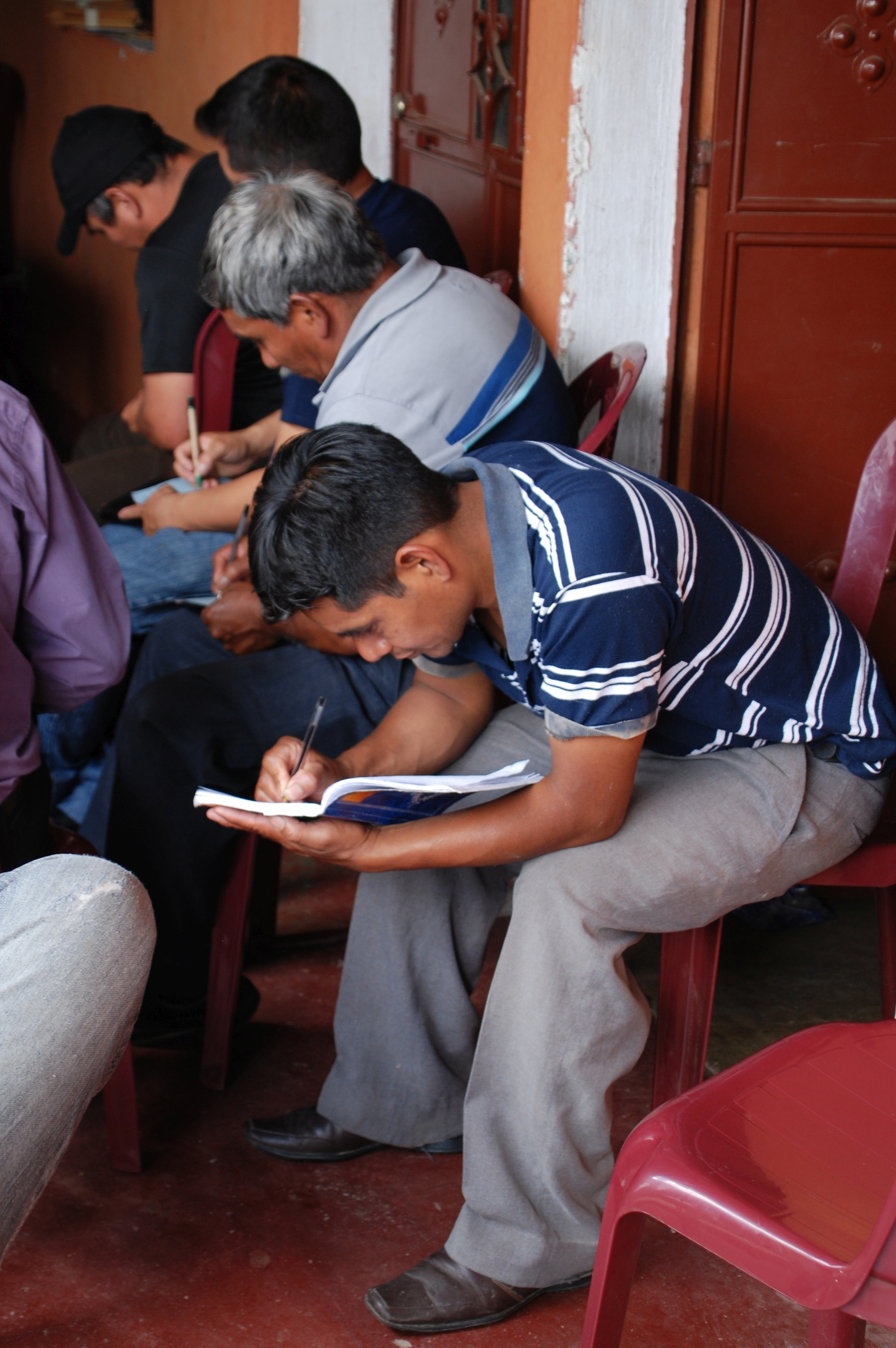 Members of Café Artesanal San Miguel co-op taking notes during one of the workshops.
