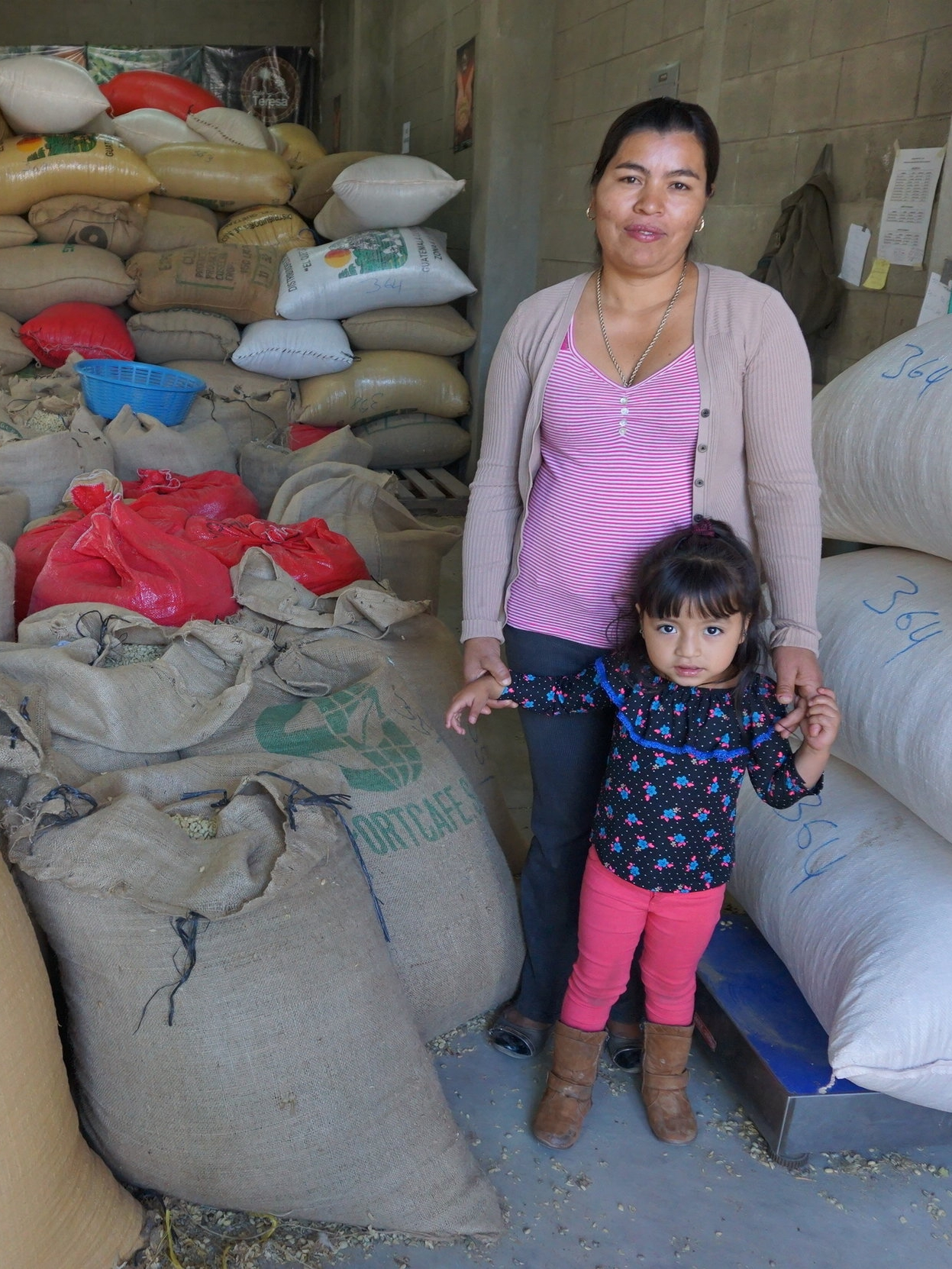 Female Coffee Farmer with her daughter