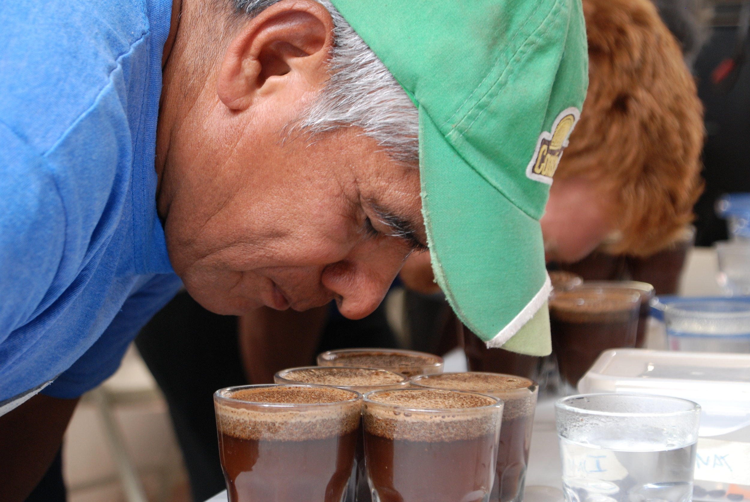 Miguel Gonzales feeling the aroma at the cupping