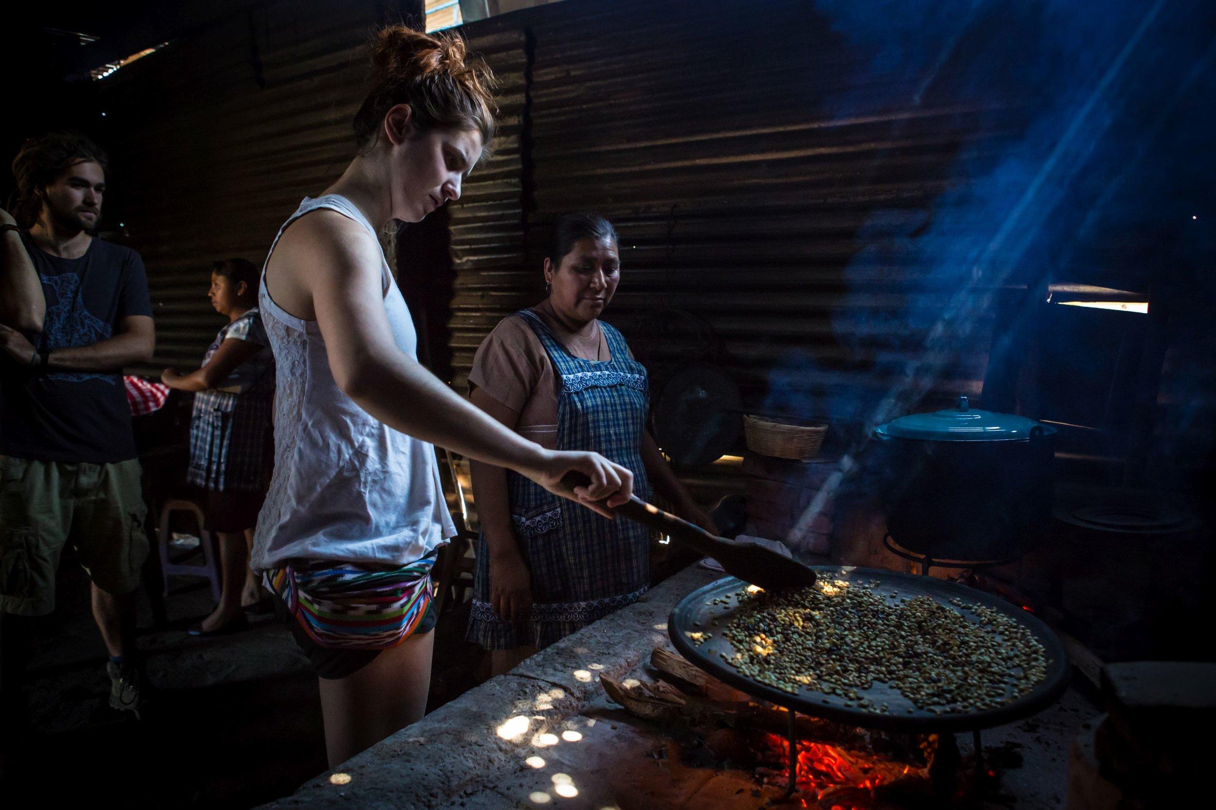 Tourist roasting coffee the traditional way.