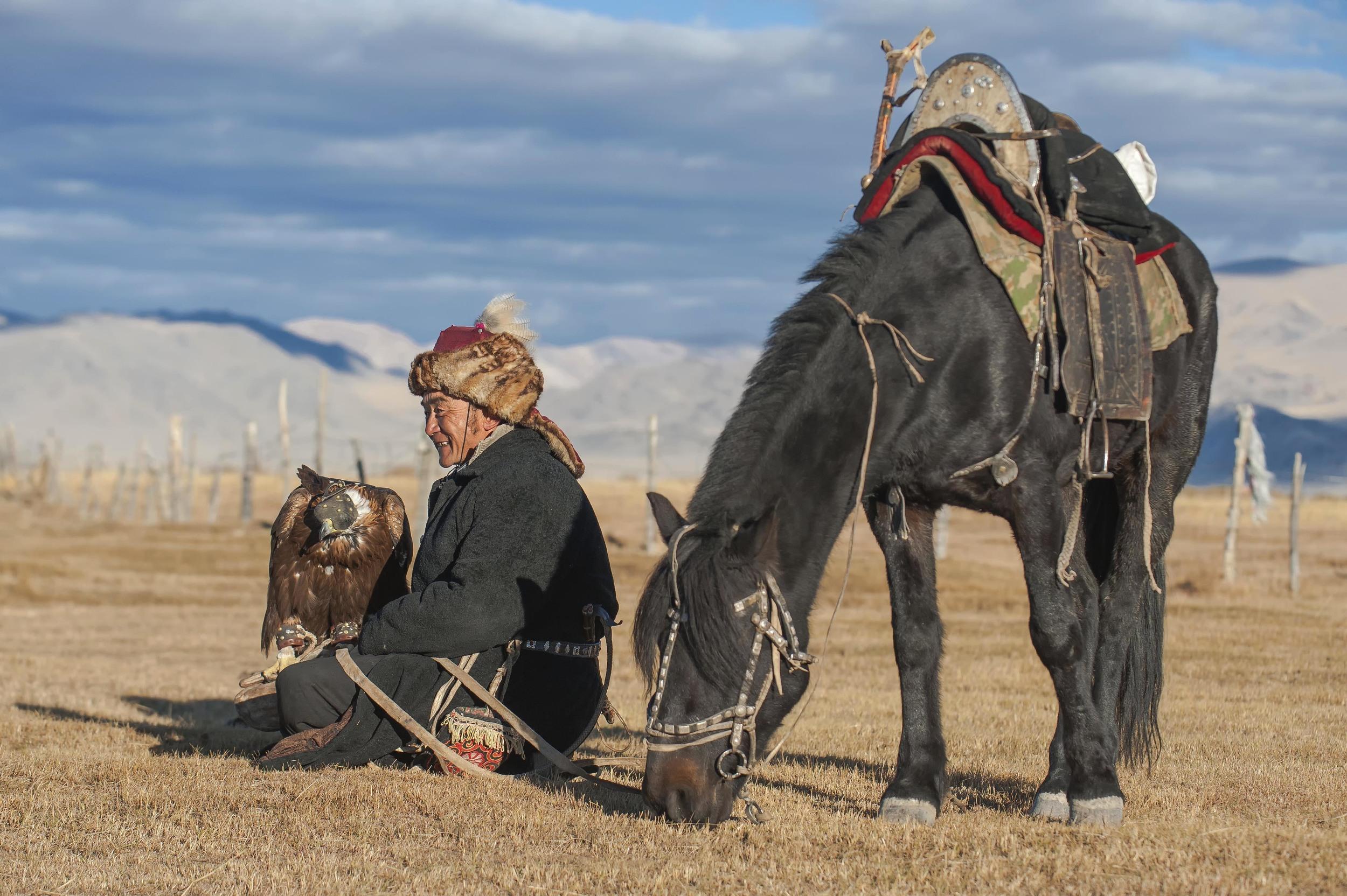 kazakh eagle hunter golden eagle and horse.jpg