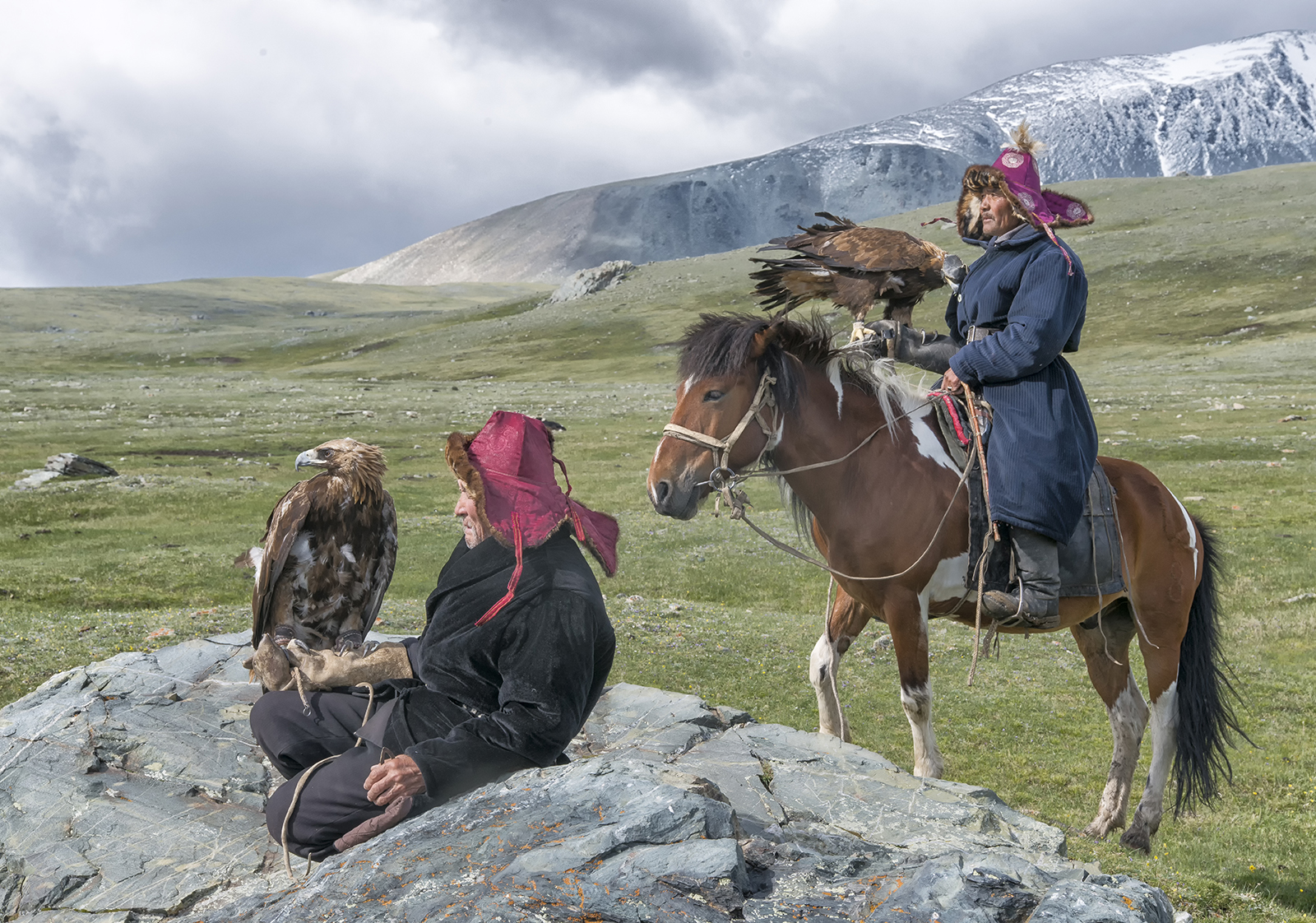 Mongolian Kazakh Eagle Hunters in the mountains.jpg