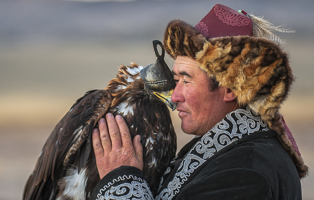 That perfect moment where man and eagle show just how close their bond is.
