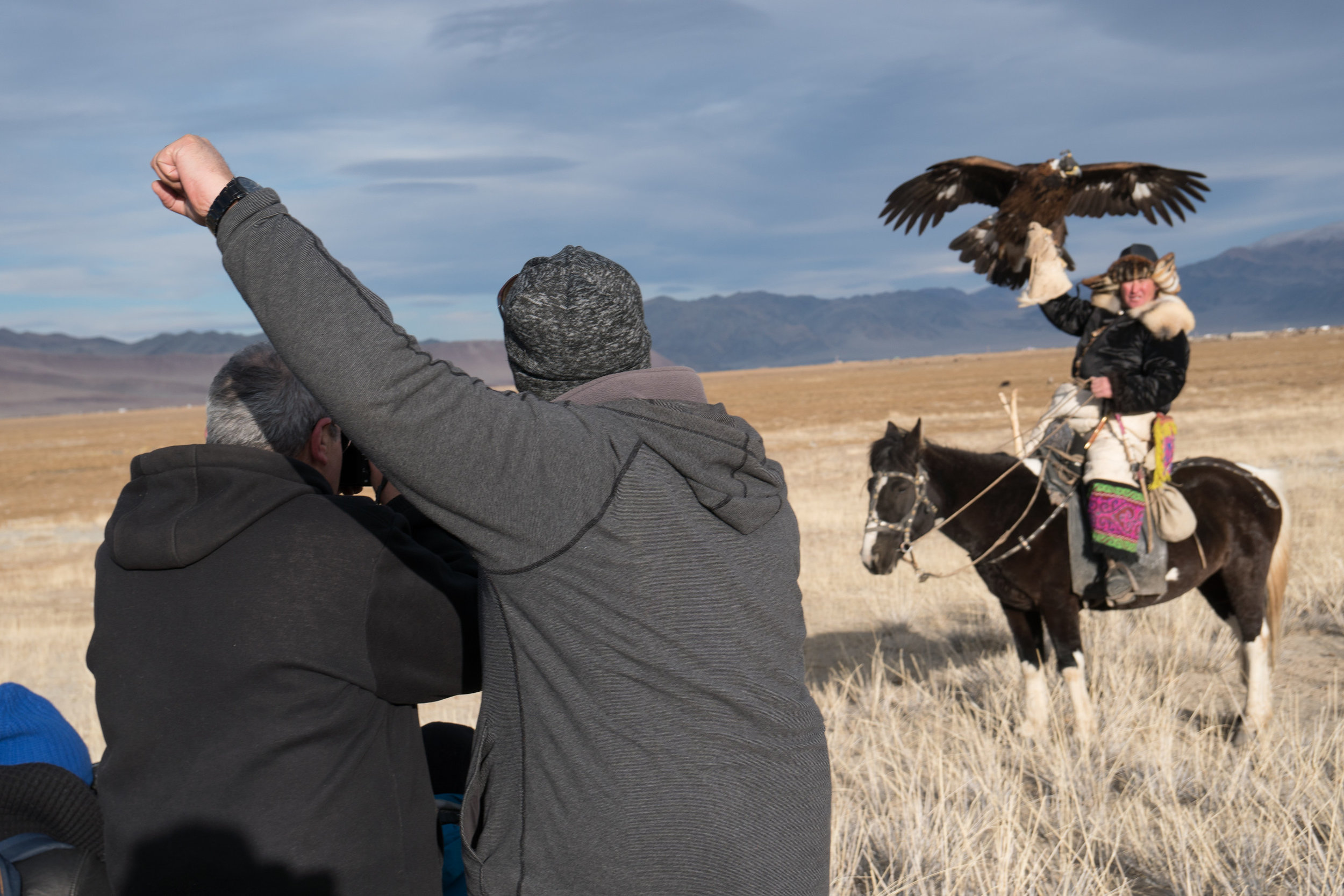 Giving the Eagle Hunter somewhere to look so the client can get a better shot