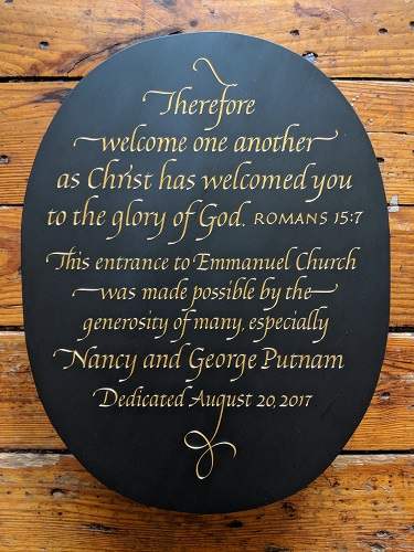 "Emmanuel Church - I was approached by a graphic designer about the possibility of carving a plaque for a beautiful church north of Boston. The design challenge was centered around there being a large amount of text having to fit into a relatively small area, as it was intended to be hung on a narrow section of wall between a stained glass window and the entrance frame. I suggested a crisp formal italic carefully flourished and set in a 13""x 17"" oval format. Hand carved in Buckingham black slate from Virginia and finished with 23K gold leaf.Location: Emmanuel Church, Manchester-by-the-Sea, MA"