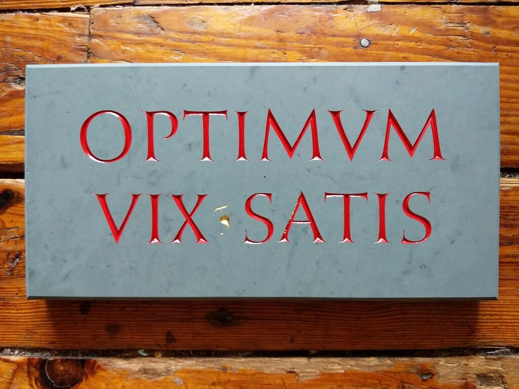 Optimum Vix Satis - Or, The Best is Hardly Good Enough. A gift for a teacher who taught me the importance of maintaining impossible standards. Carved in Vermont Green slate and painted red with a touch of 23 K gold leaf.