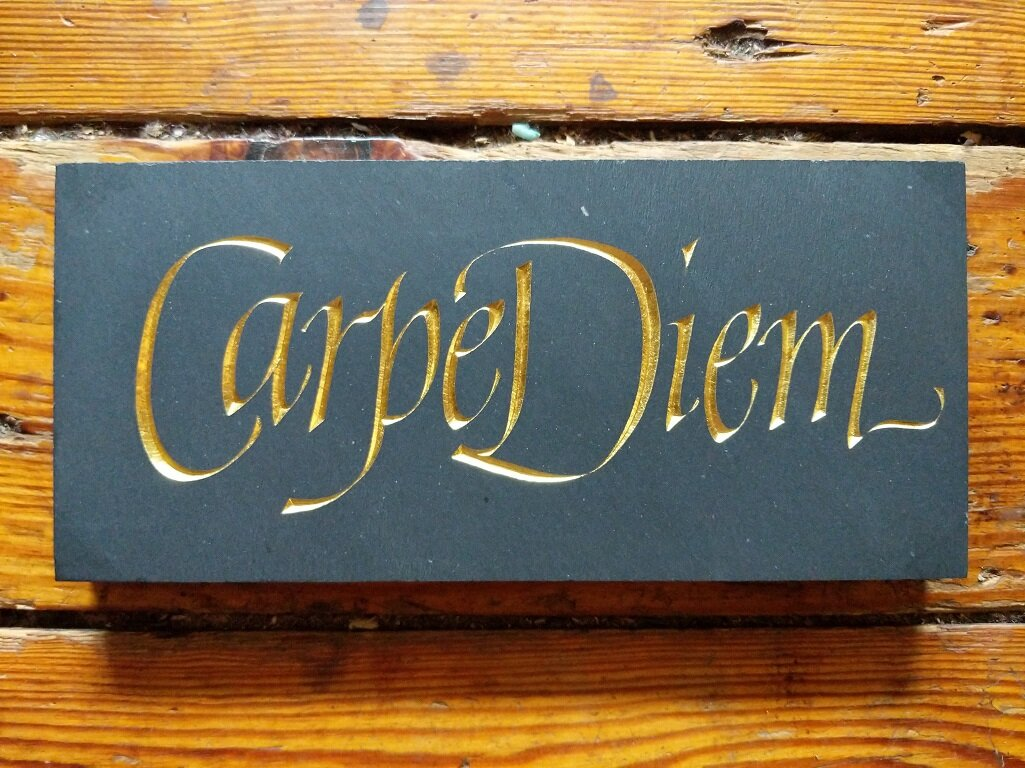 Carpe Diem - A small personal project carved in Buckingham Black slate and finished in 23 K gold leaf in honor of a dearly departed friend for whom this served as a motto.