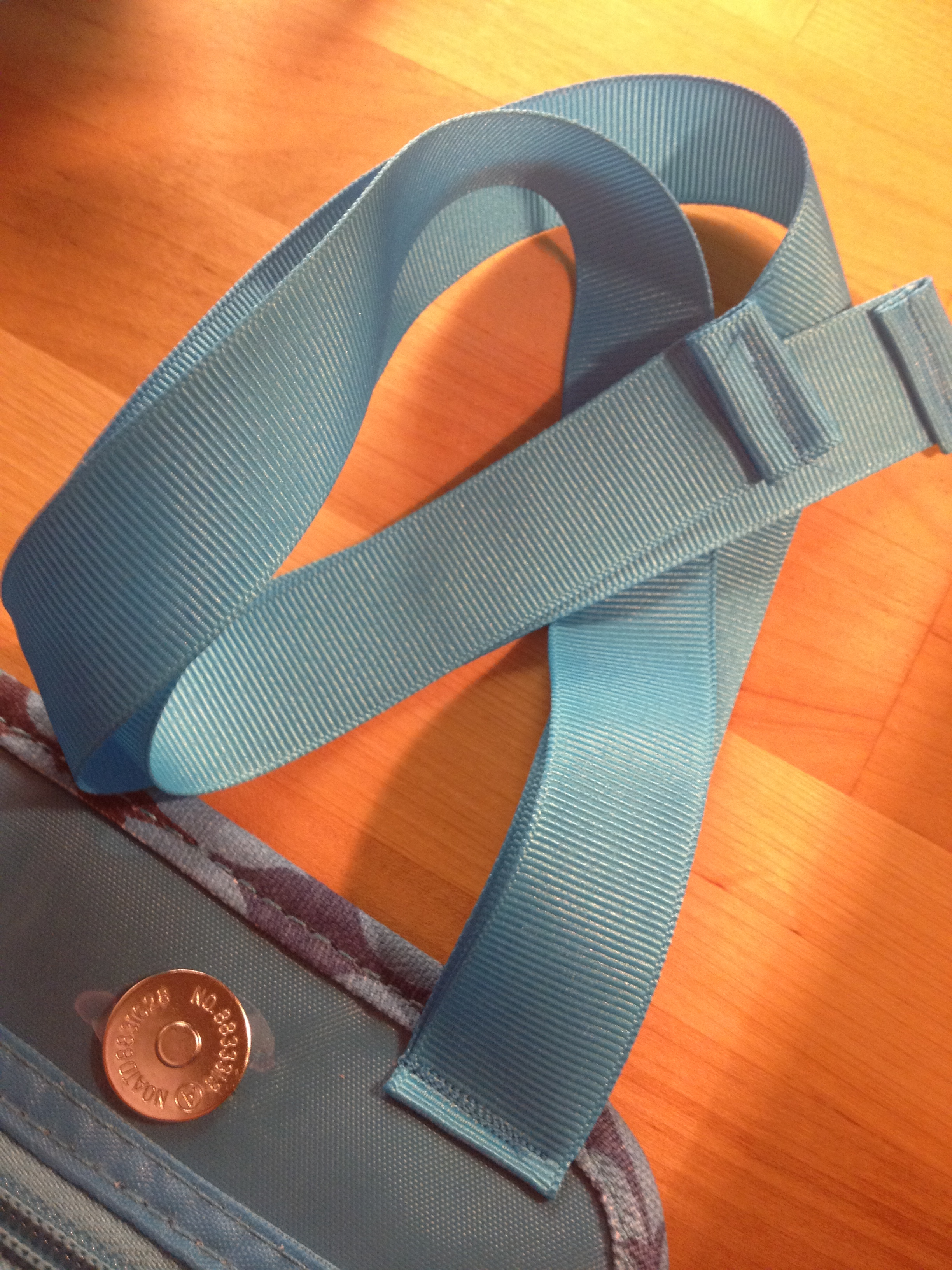 I hemmed the ribbons and them sewed them to the top of the organizer.