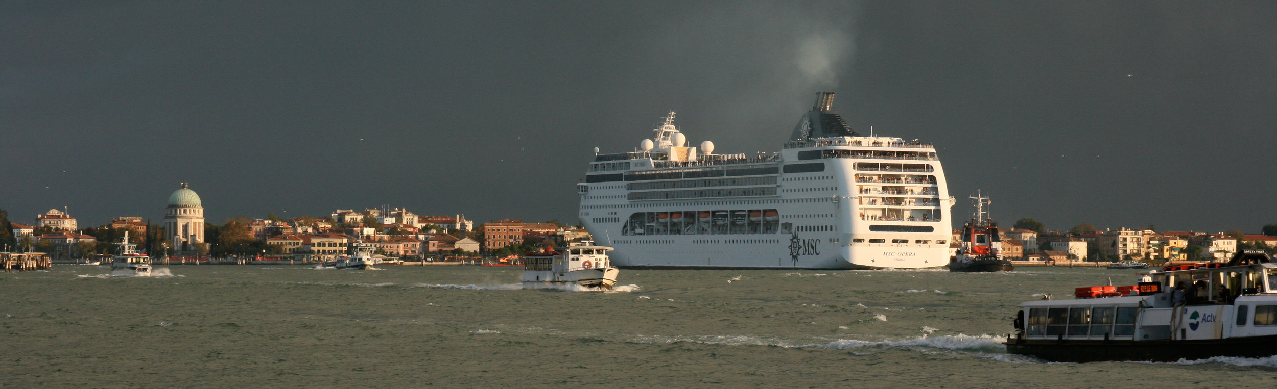A cruise ship leaving port in Venice
