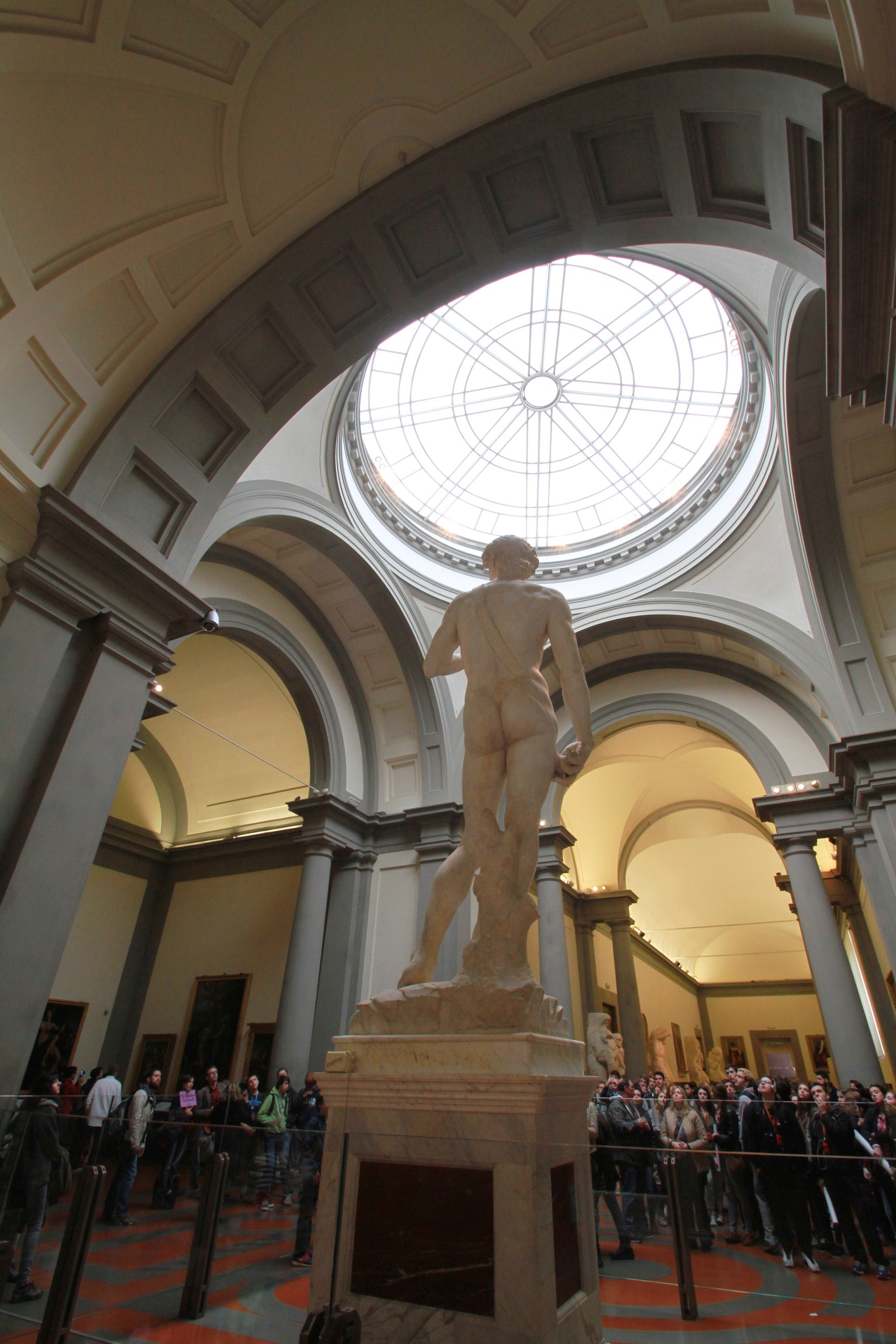 Crowds admire Michelangelo's David at the Academy in Florence