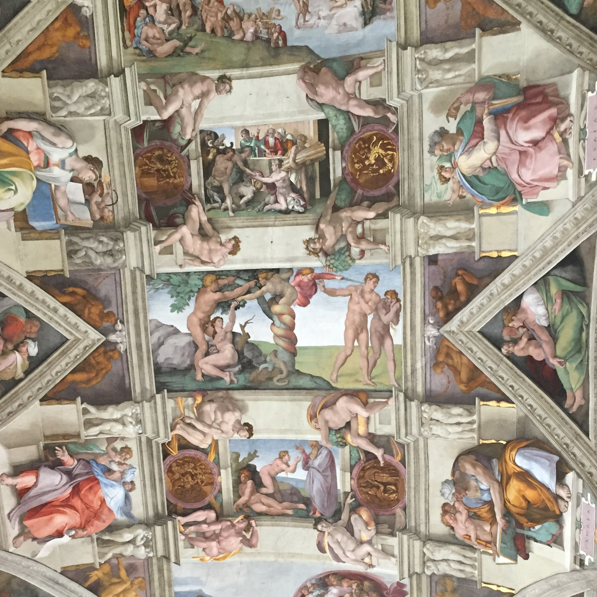 Michelangelo devised a system of organizing the ceiling frescoes painting in architectural elements using a technique called trompe l'oeil — to fool the eye. It is all pigment and plaster.