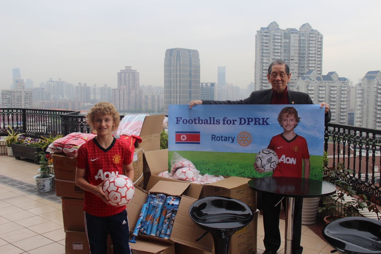 Mac Millar inspects footballs donated by Rotarians with the support of Shanghai Rotary club Past President Frank Yih's Huaqiao Foundation.