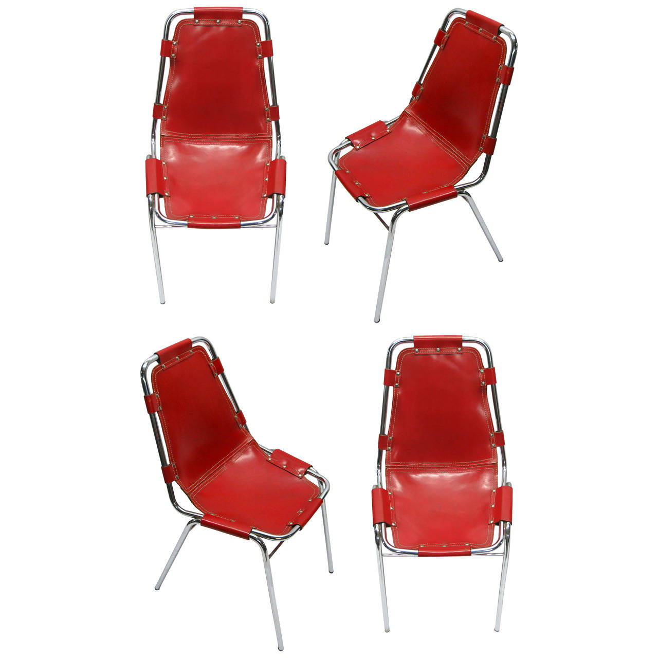 four red chairs by charlotte perriand