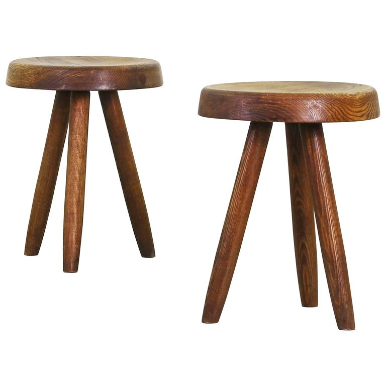 pair of stools by charlotte perriand