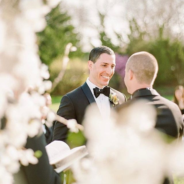 Remembering this day just about a year ago. Spring IS coming! A huge smile during vows captured through spring blossoms by @rebeccayale. Full day feature coming soon to @theknot #realwedding #ceremonydecor #ceremony #loveislove #thechanlerwedding #newportwedding #newportriwedding #newenglandwedding #riweddings