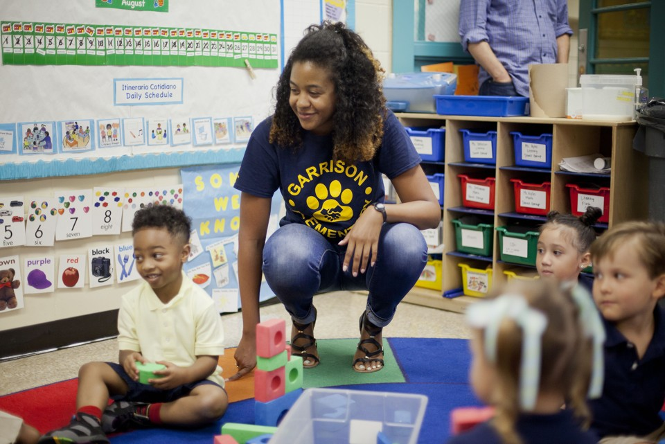 African-American Female Teacher Classroom.jpg
