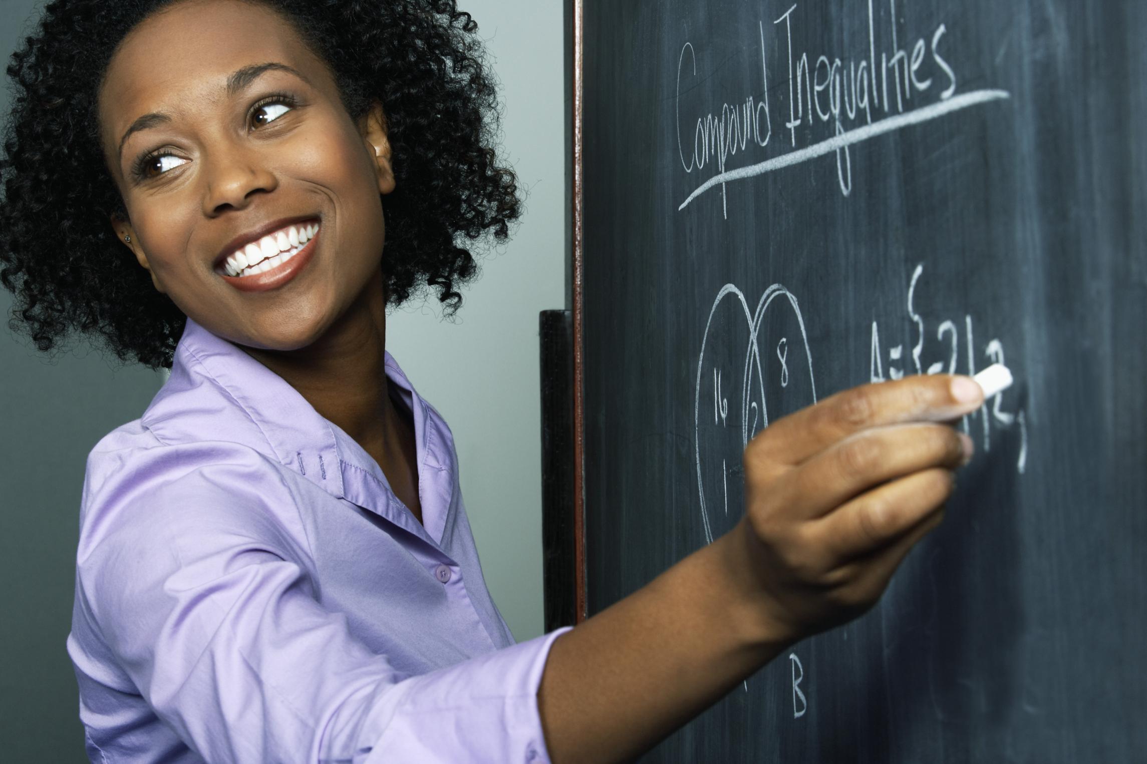 African-American Female Teacher Chalkboard LARGE.jpg