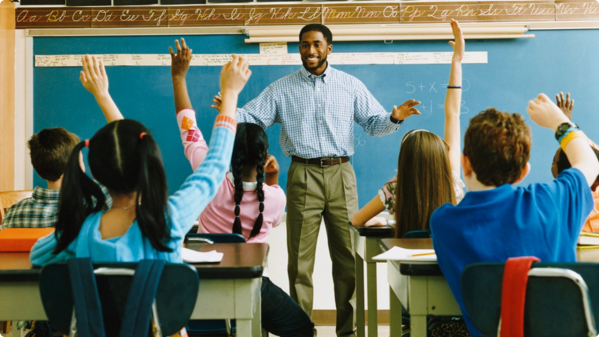 African-American Male Teacher Classroom Standing LARGE.png