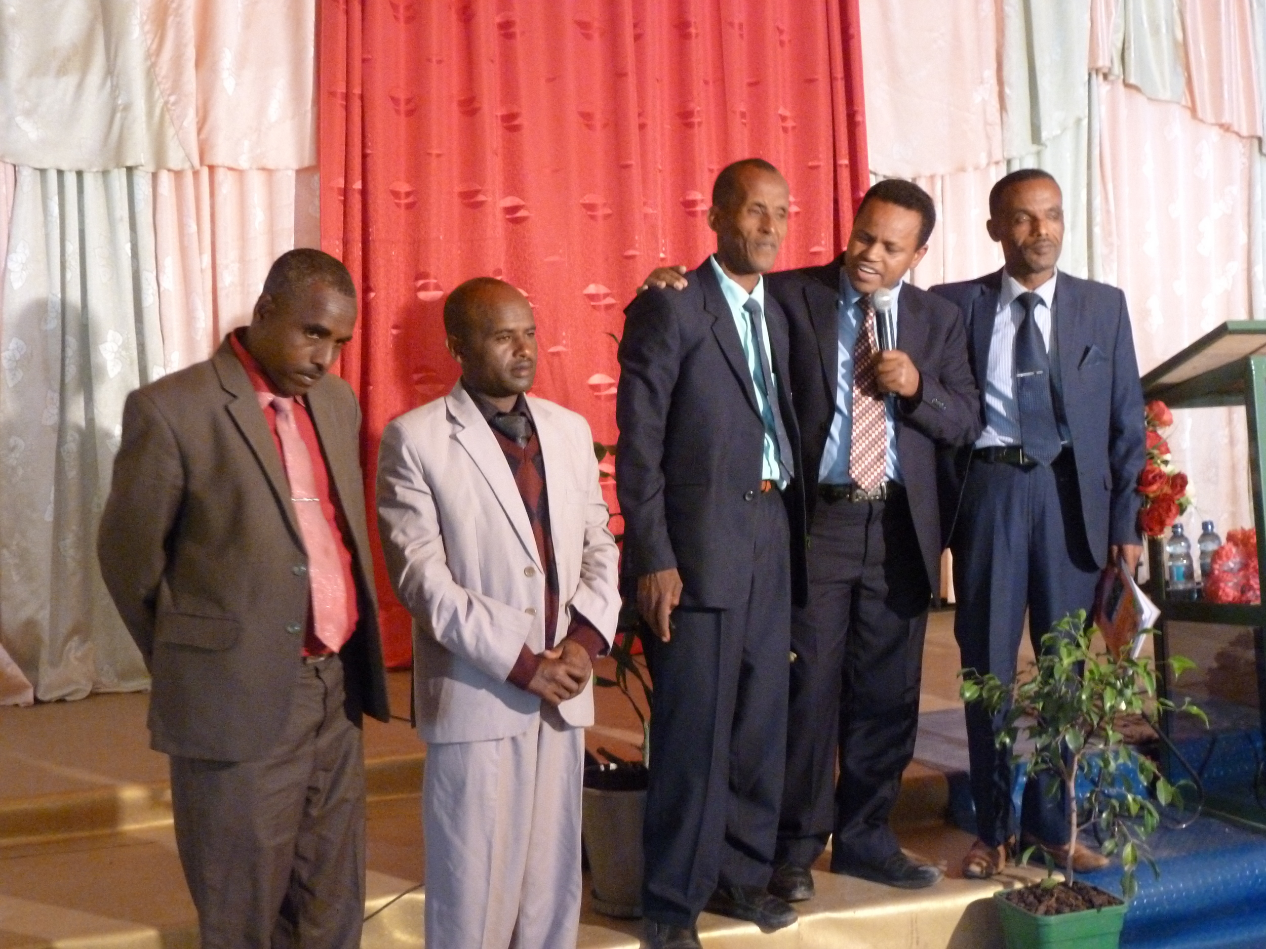 4 of our first pioneer evangelists with Mulugeta with the microphone, my right hand man
