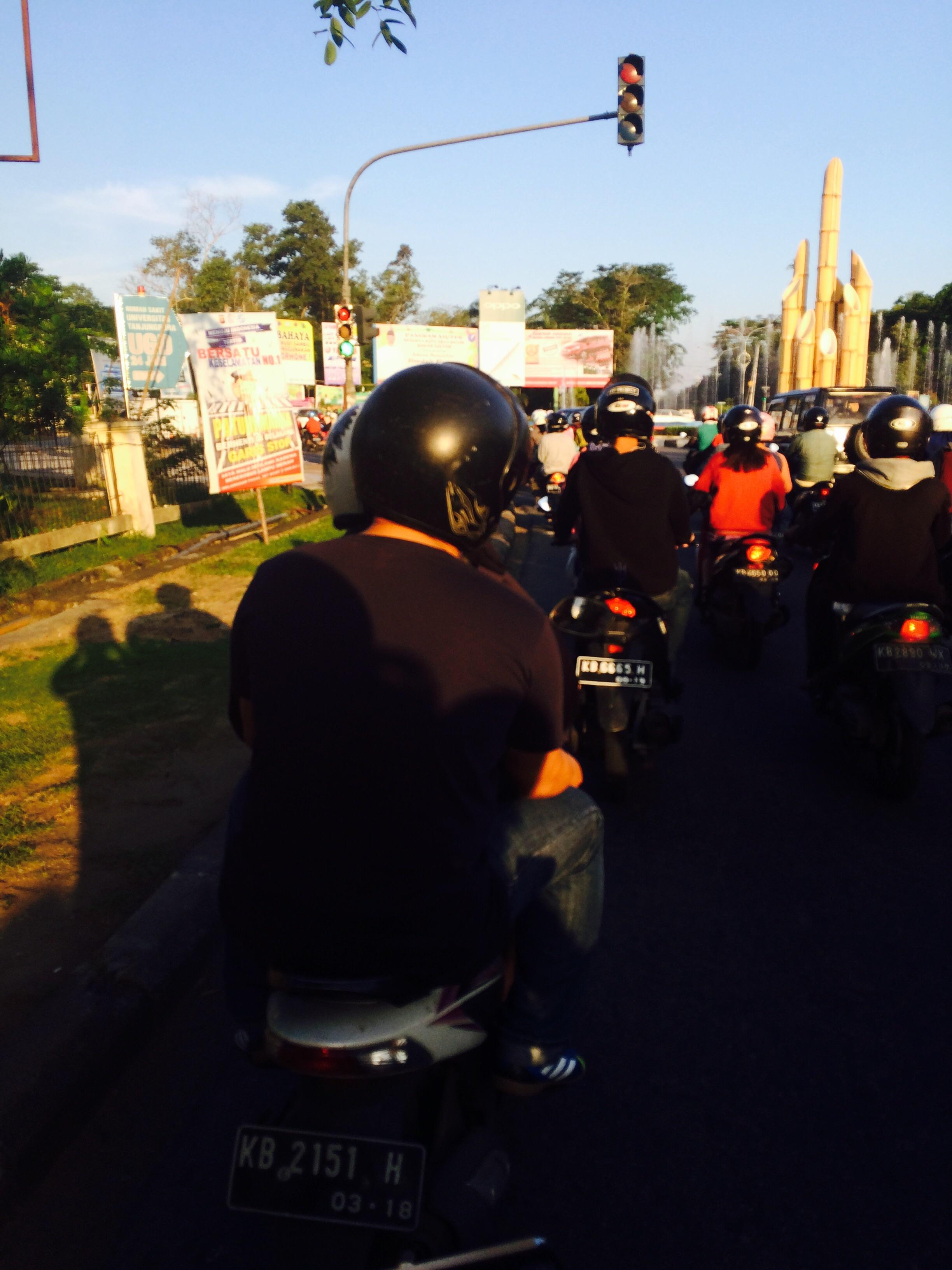Pontianak rush hour with multitudes of motorbikes.