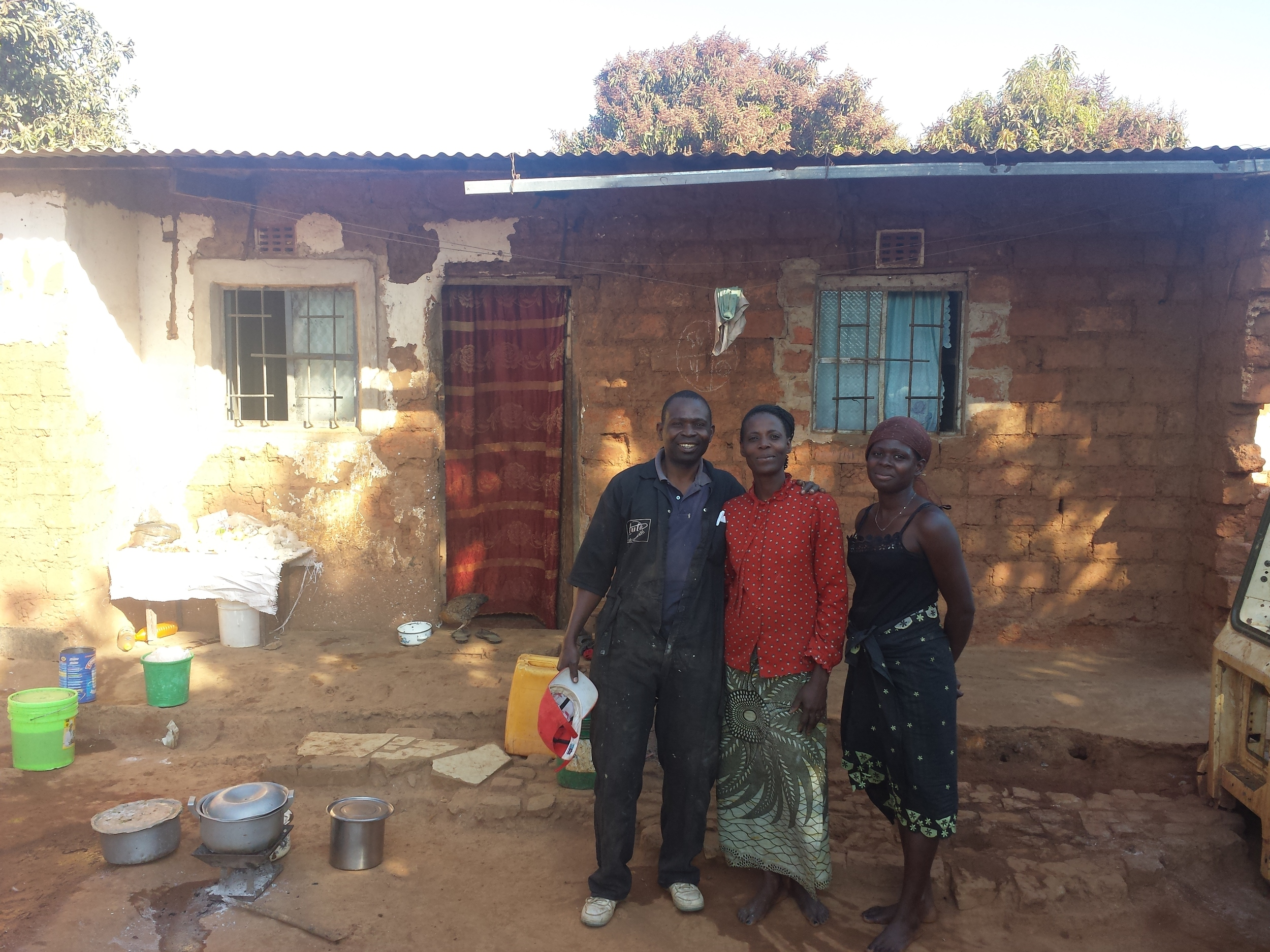 This is Andre, his wife and one of his 7 children.