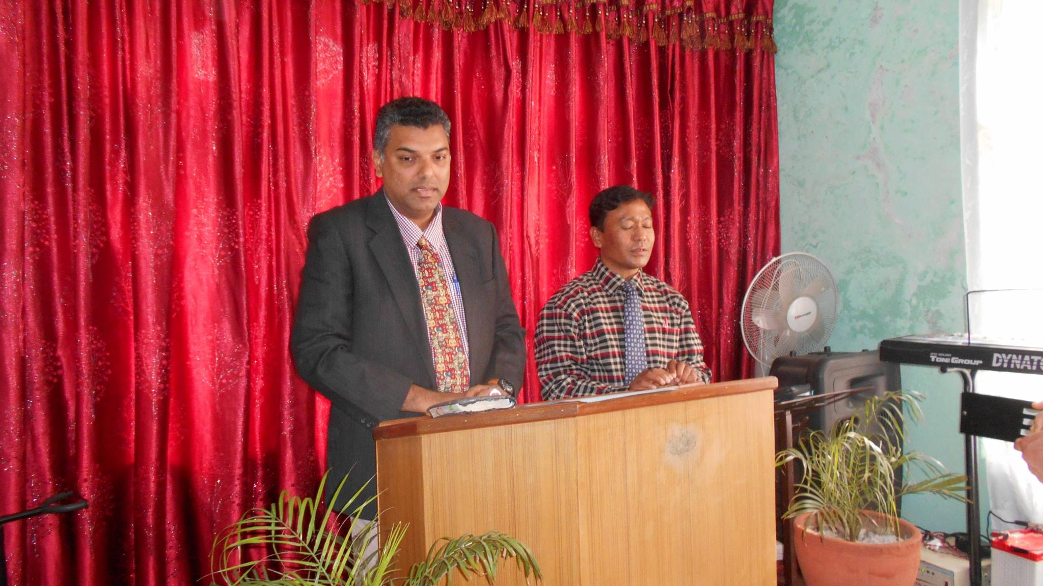 Nilesh preaching at Bhaktapur assembly with translation.