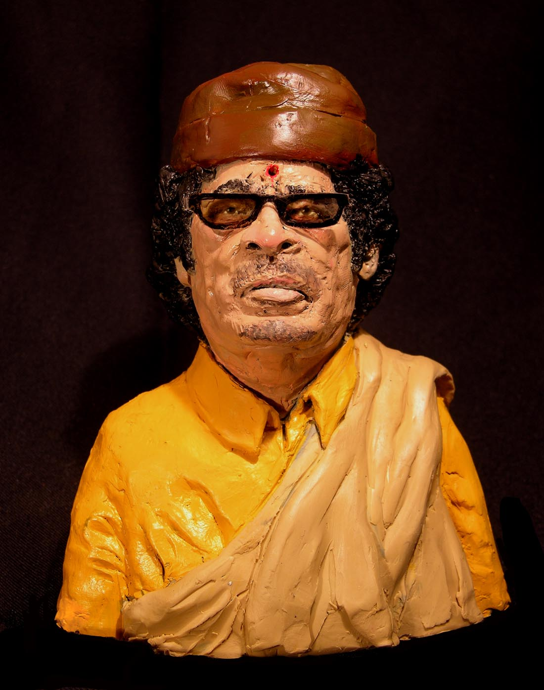 Muammar Muhammad Abu Minyar al-Gaddafi, commonly known as Colonel Gaddafi , shown with a bullet hole to the head