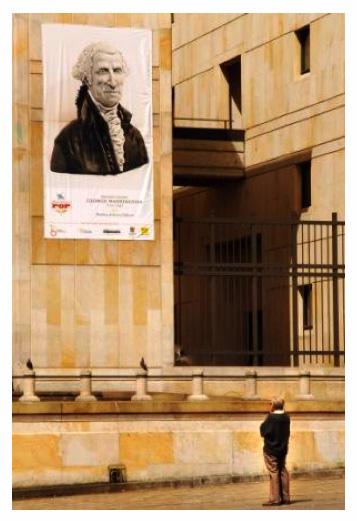Huge banner of the George Washington Head hanging out side the Plaza de Bolivar Bogotá Colombia