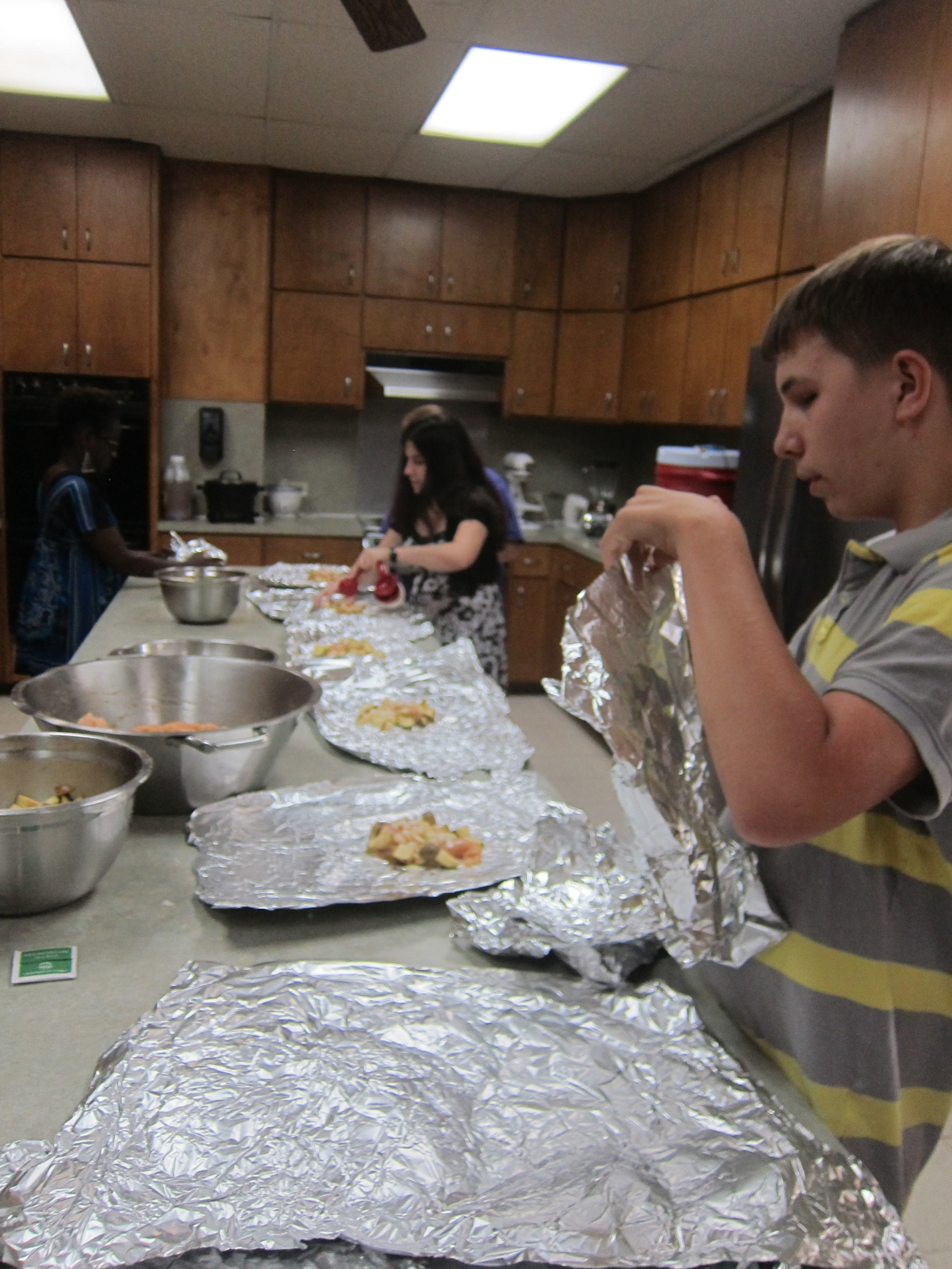 Bre Brown, NABS representative, and Nathan using team work to prepare dinner
