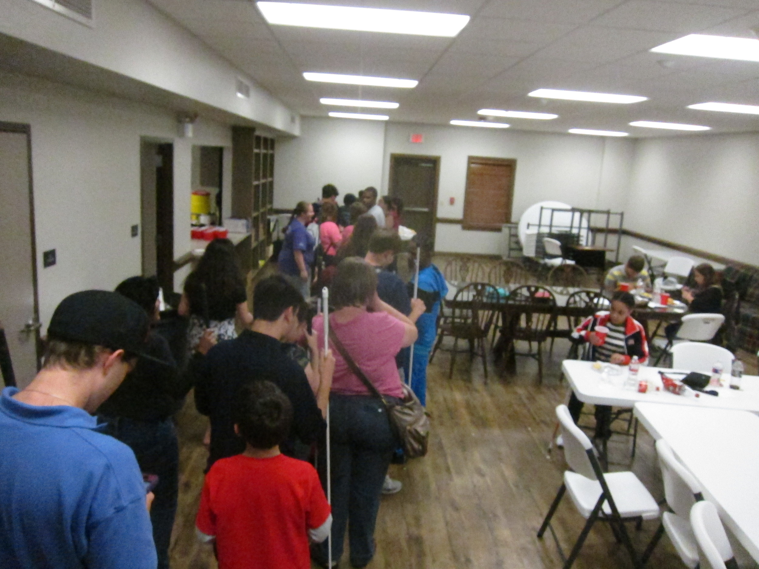 Group shot of everyone lined up to eat--what a great turnout