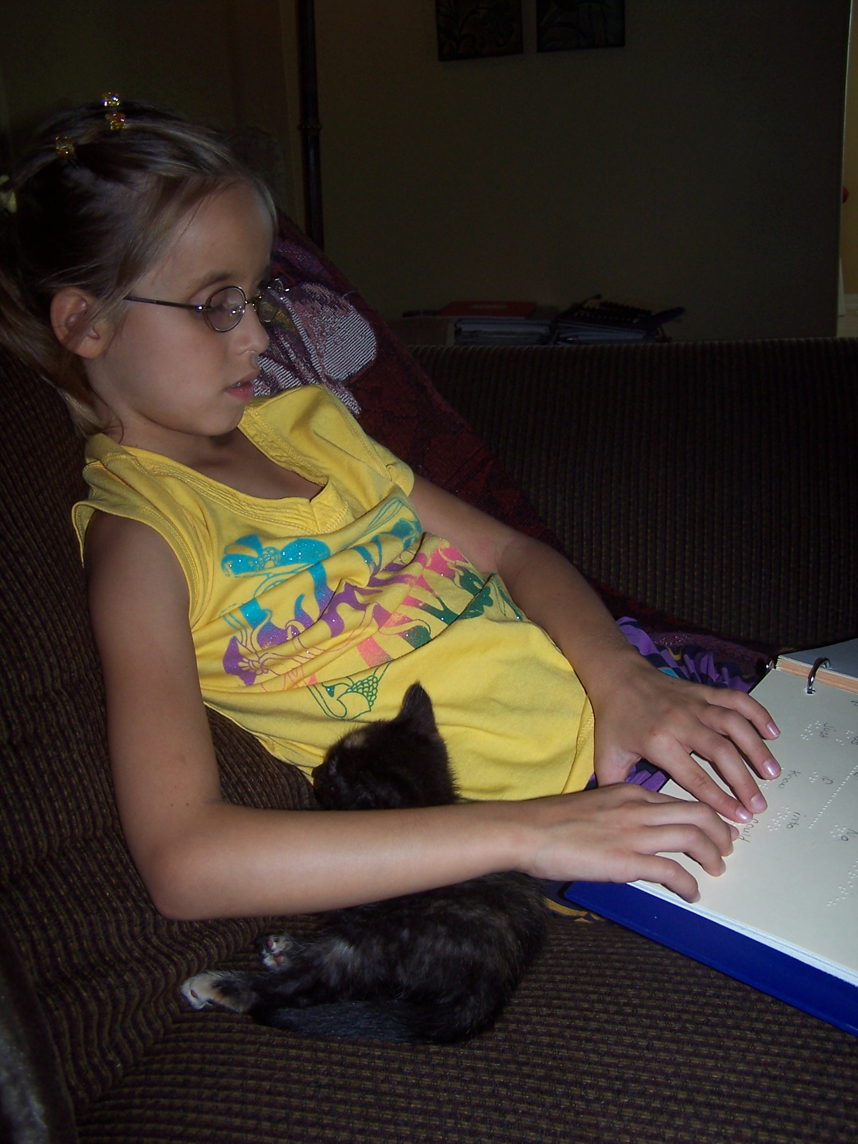 Lindsay chills with a kitten while reading