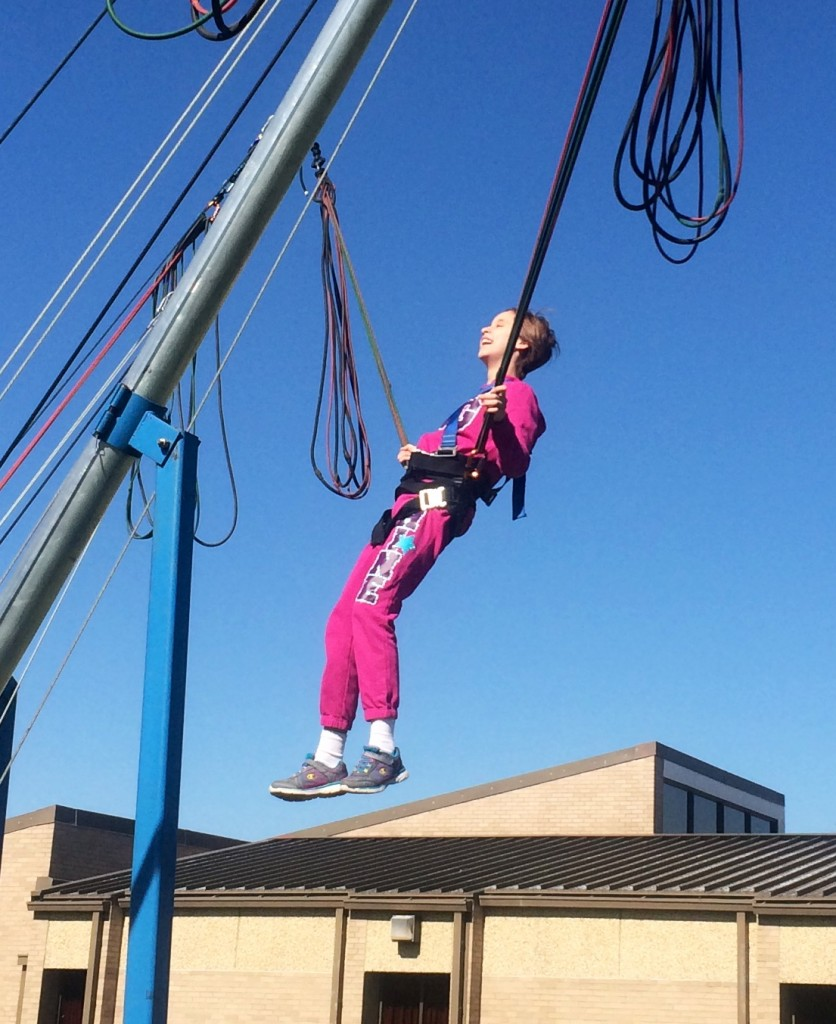 Lindsay enjoys the bungee jumping device at a Spring Festival