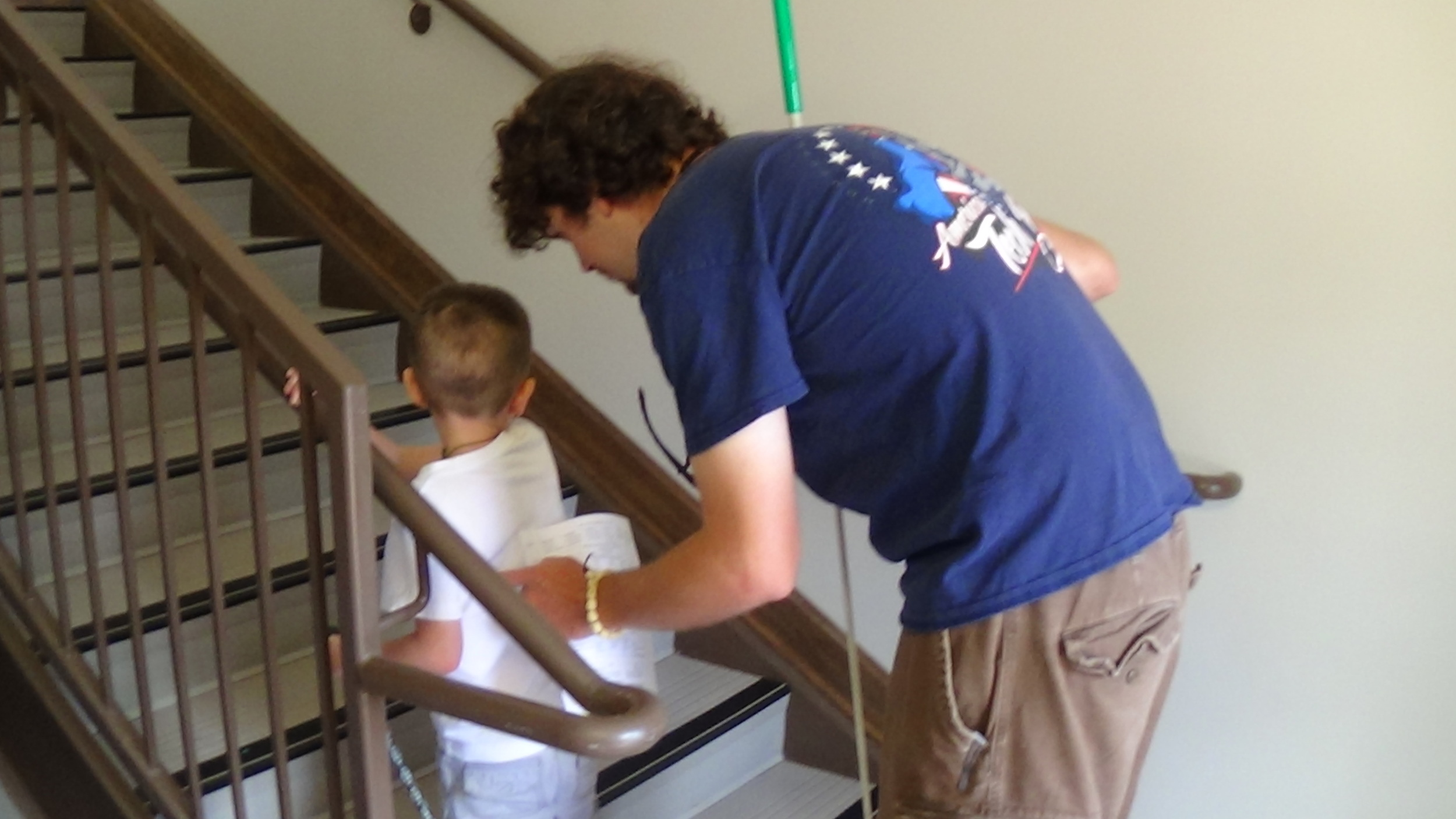 Justin gives Jordan guidance on climbing the stairs