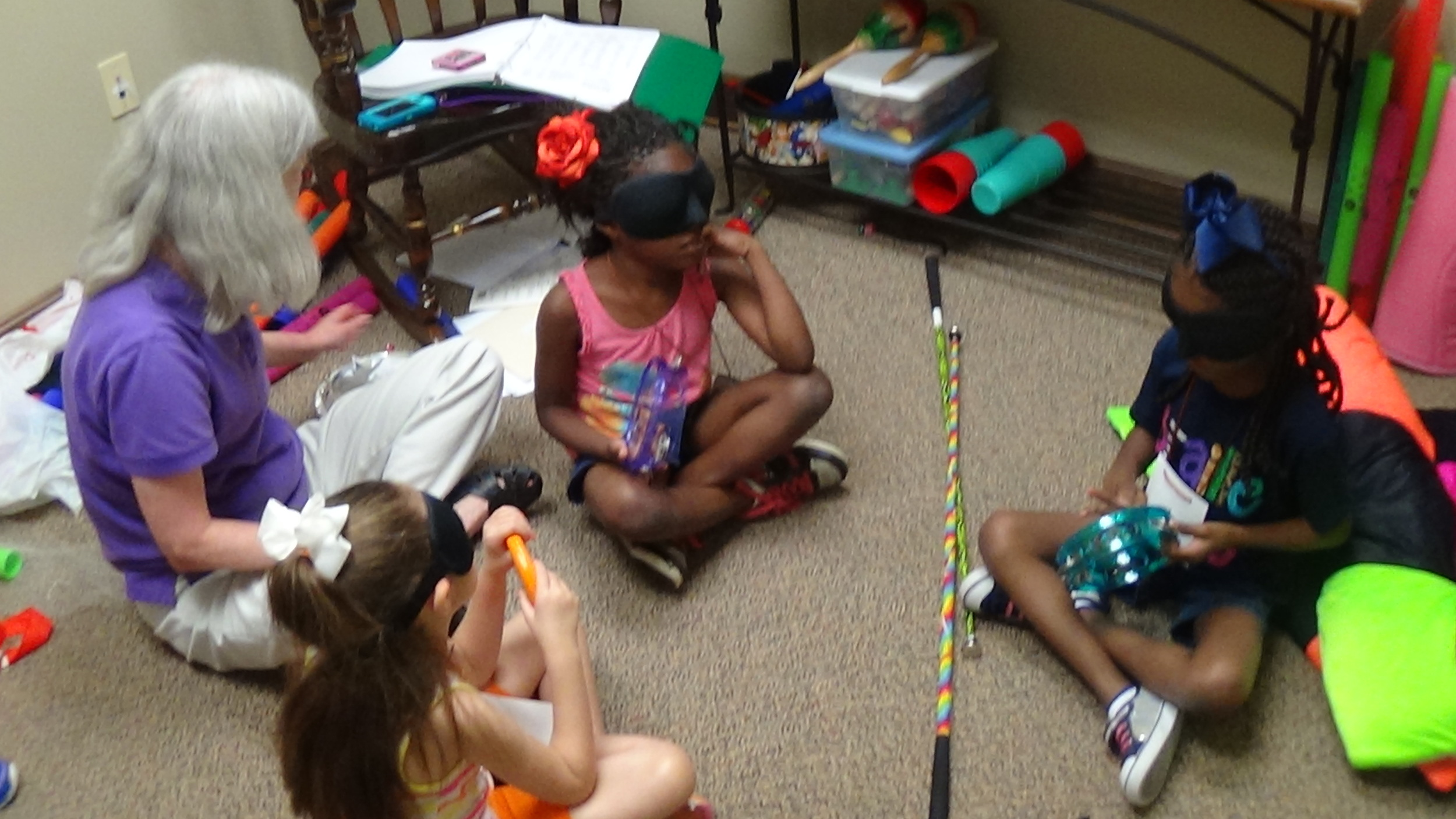Ms. Sarah and students enjoy music class nonvisually